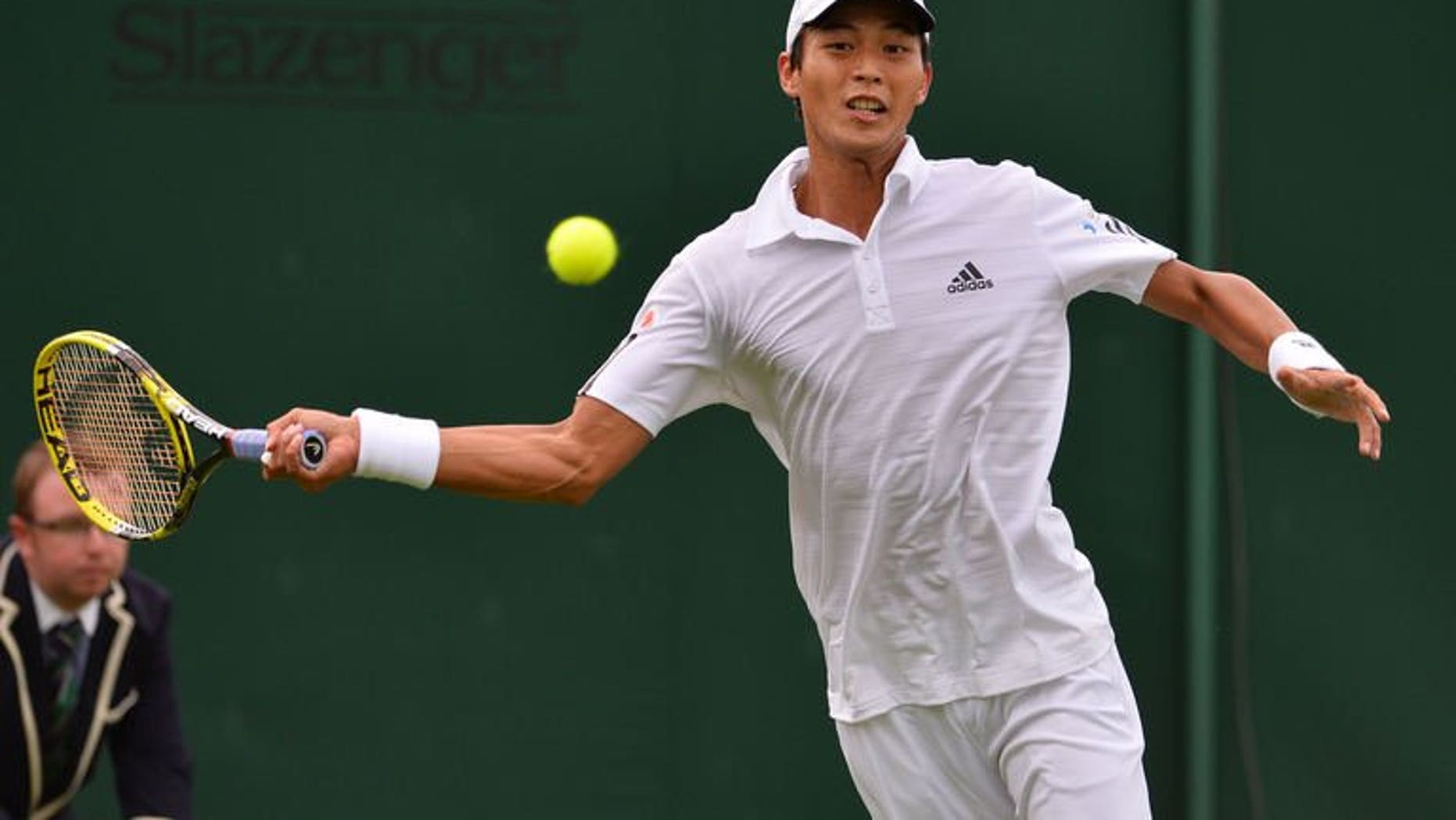 Taiwan's Lu Yen-Hsun hits a return on day one of the 2013 Wimbledon Championships at the All England Club in London, on June 24, 2013. Lu hopes to draw inspiration from his 2008 Olympics victory over Andy Murray when he clashes with the world number two for a place in the Wimbledon third round on Wednesday.