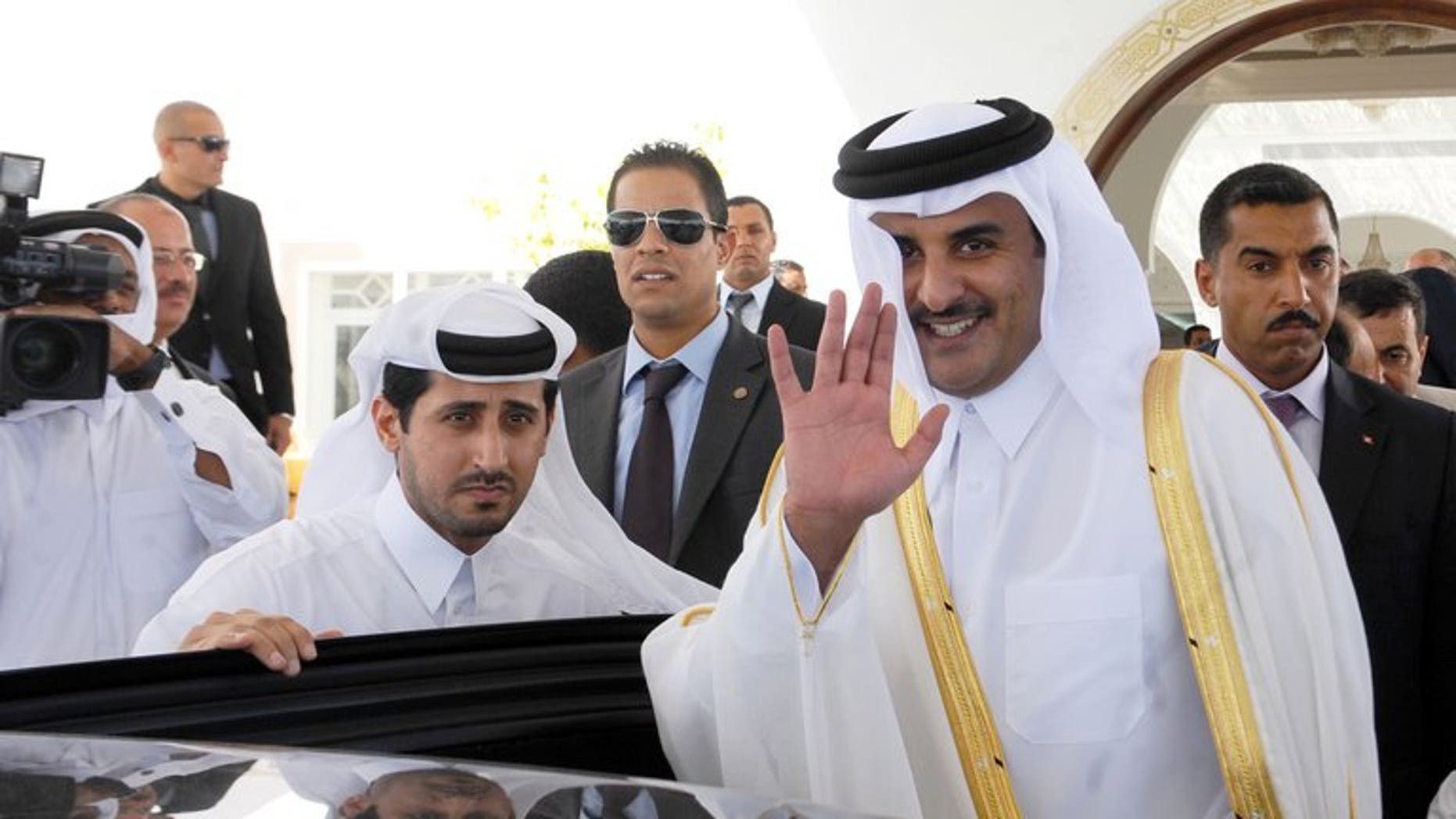 Sheikh Tamim bin Hamad al-Thani waves for photographers upon arrival in Tunis on July 16, 2012. Since his appointment as heir apparent a decade ago, Sheikh Tamim has held top security and economic posts, as well as overseeing Qatar's ambitious plans to use sports to raise its international profile.
