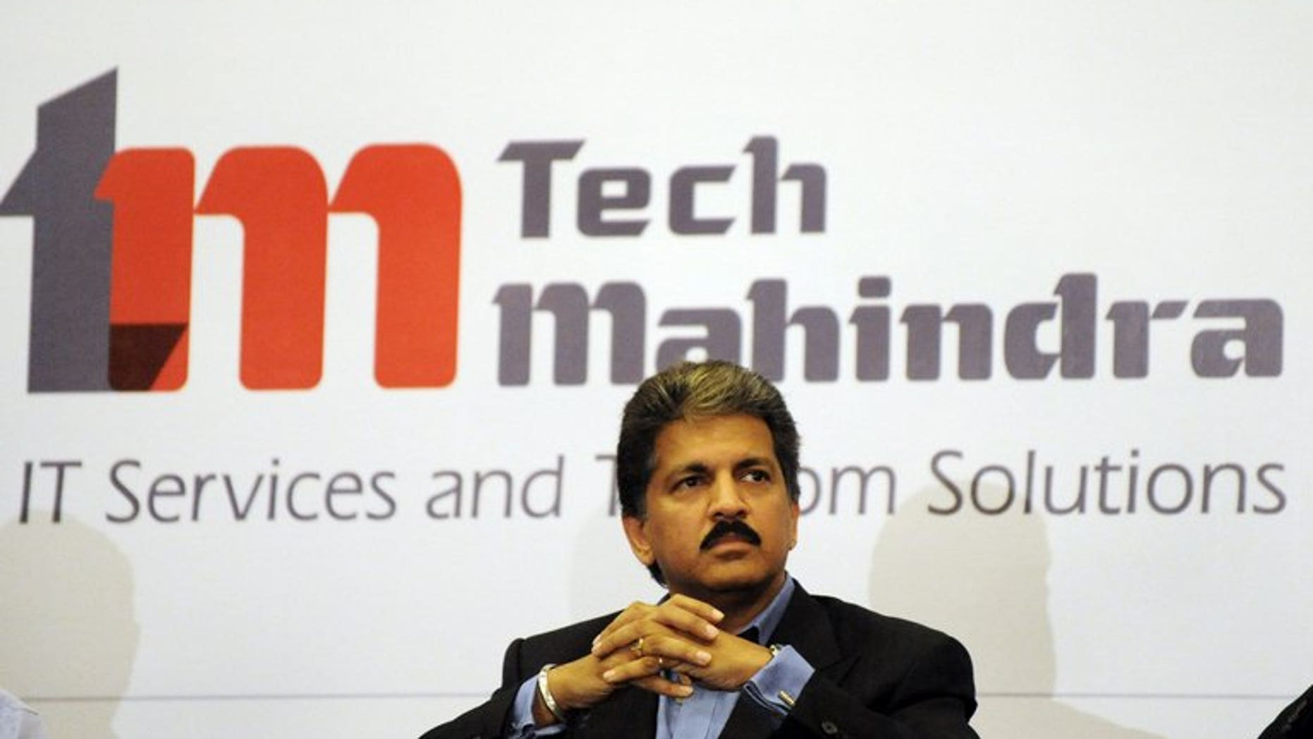 Anand Mahindra listens to a question during a press conference in Hyderabad on April 20, 2009. Indian IT outsourcer Tech Mahindra on Tuesday completed a takeover of its partly-owned unit Mahindra Satyam, creating a new force in the sector with annual revenues of $2.7 billion.