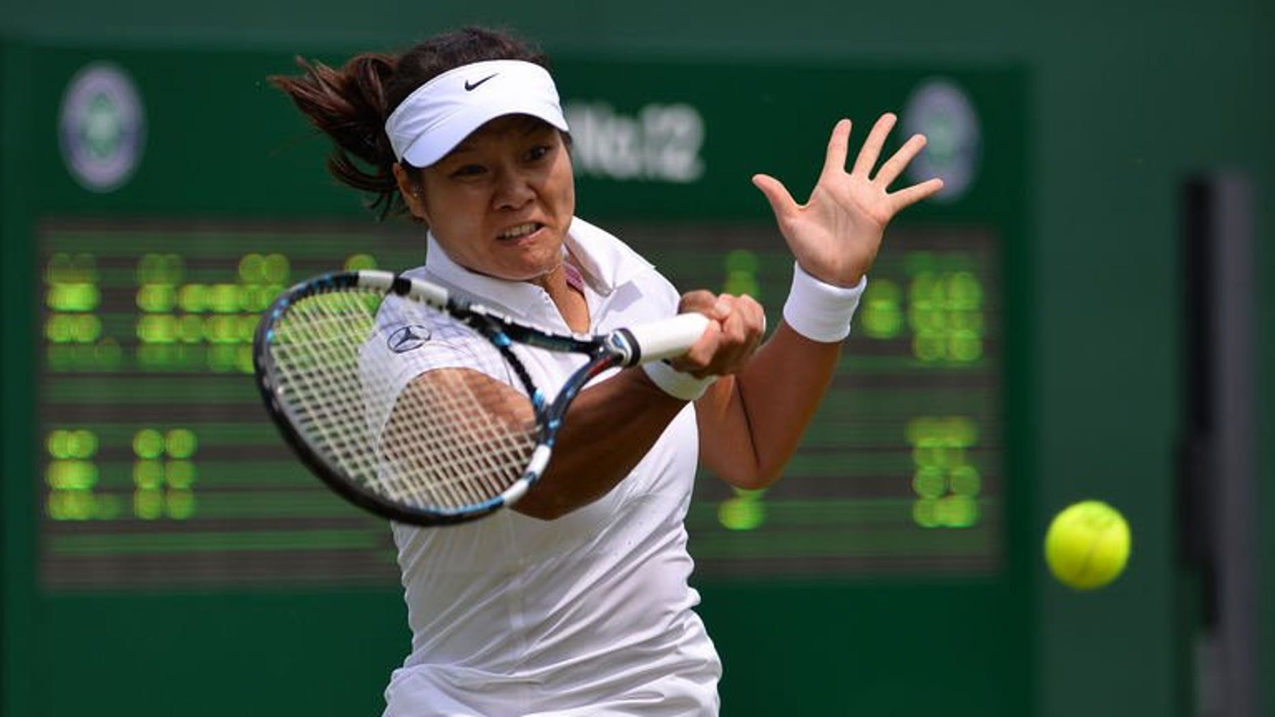 China's Li Na returns against Michaella Krajicek during their women's first round match on day two of the 2013 Wimbledon Championships tennis tournament at the All England Club in Wimbledon, southwest London, on June 25, 2013. Li won 6-1, 6-1.