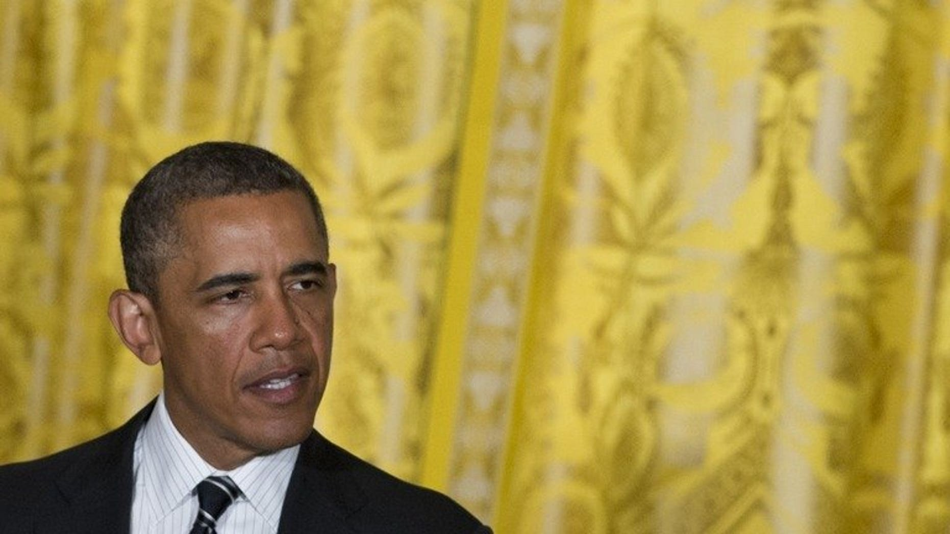 US President Barack Obama speaks during a LGBT Pride Month celebration in the East Room of the White House in Washington, DC, June 13, 2013. Obama is unlikely to see critically ill Nelson Mandela when he visits South Africa later this week, the country's minister of international relations said Tuesday.