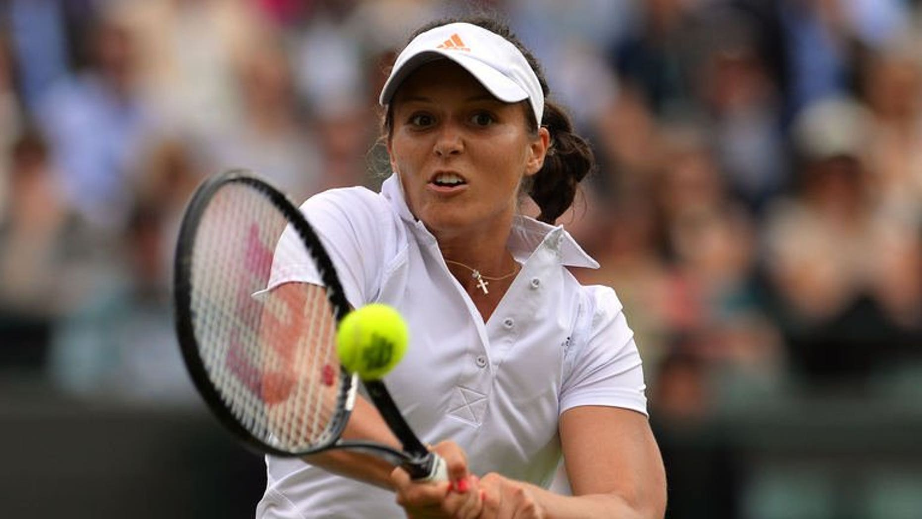 Britain's Laura Robson returns on her way to beating Russia's Maria Kirilenko during their women's first round match on day two of the 2013 Wimbledon Championships tennis tournament at the All England Club in Wimbledon, southwest London, on June 25, 2013. Robson won 6-3, 6-4.