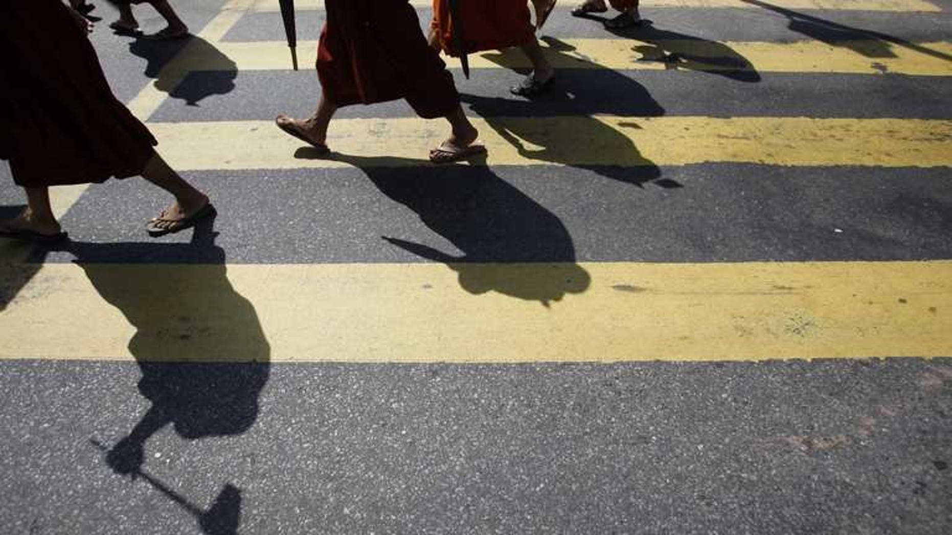 "Myanmar Buddhist monks take part in a demonstration against the Organisation of the Islamic Conference in Yangon on October 15, 2012. Myanmar late Tuesday banned a controversial Time magazine cover story on Buddhist-Muslim religious violence ""to prevent further conflict"", according to a government spokesman, after days of angry reaction to the article."
