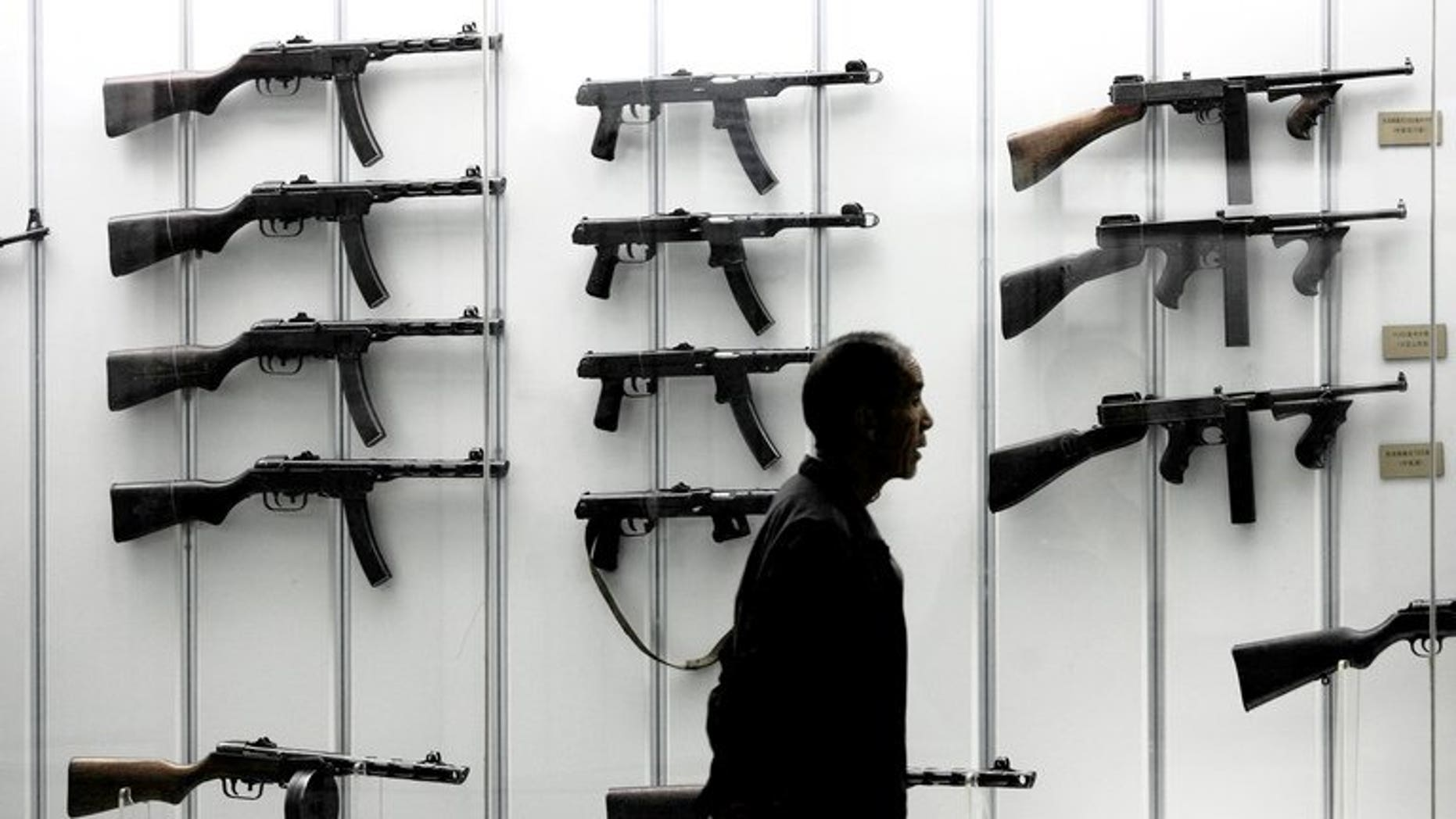 A visitor looks at a display of guns at the military museum in Beijing on June 13, 2006. Defence budgets in the Asia Pacific region will overtake the United States and Canada by 2021, according to a study by respected analysts IHS Jane's published on Tuesday.