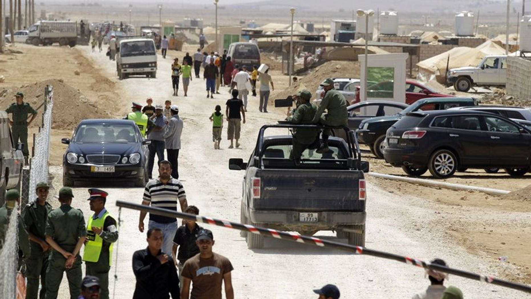 Jordanian security guards patrol the entrance to Zaatari refugee camp, near the border with Syria, on August 15, 2012.