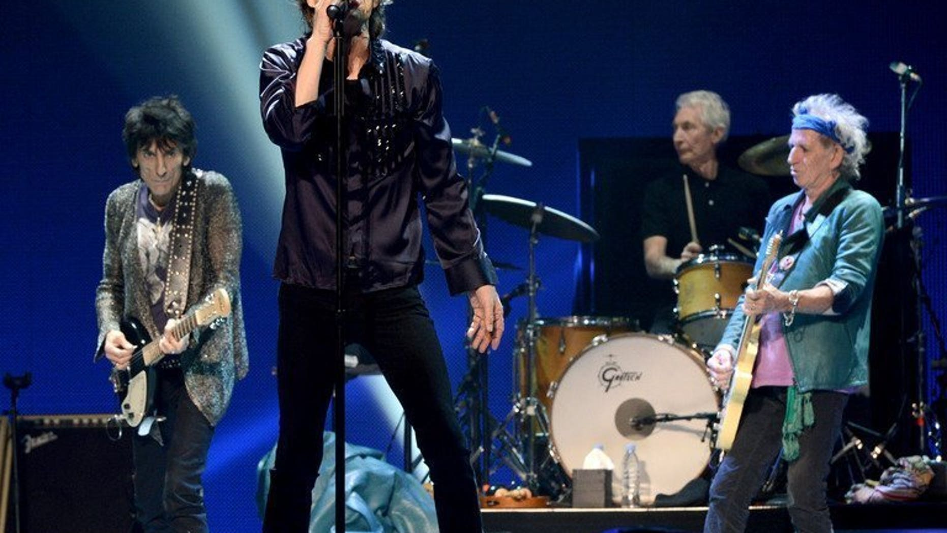 """Rolling Stones singer Mick Jagger performs with his band at The Honda Center in Anaheim, California on May 15, 2013. Jagger admitted on Friday he has found his career in the Rolling Stones """"intellectually undemanding"""" and sometimes wishes he had stuck to his original idea of becoming a teacher."""