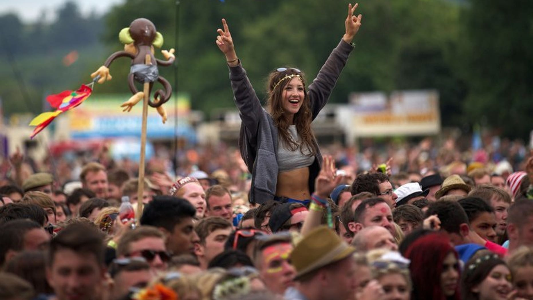 Festival goers attend concerts at the Pyramid Stage at the Glastonbury Festival, southwest England, on June 28, 2013. Tens of thousands of people braved the traditional swamp of mud to watch the first acts of the Glastonbury festival, starting with Liam Gallagher's band and culminating in a vintage performance from Arctic Monkeys.