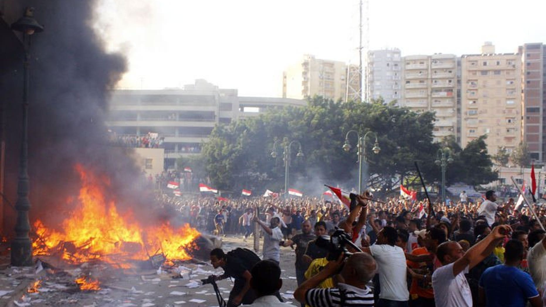 """Opponents of Egyptian President Mohamed Morsi burn the content of a Freedom and Justice Party office in the coastal city of Alexandria on June 28, 2013. US President Barack Obama has expressed concern about political clashes in Egypt and called on Morsi to be more """"constructive"""" in moving the country forward."""