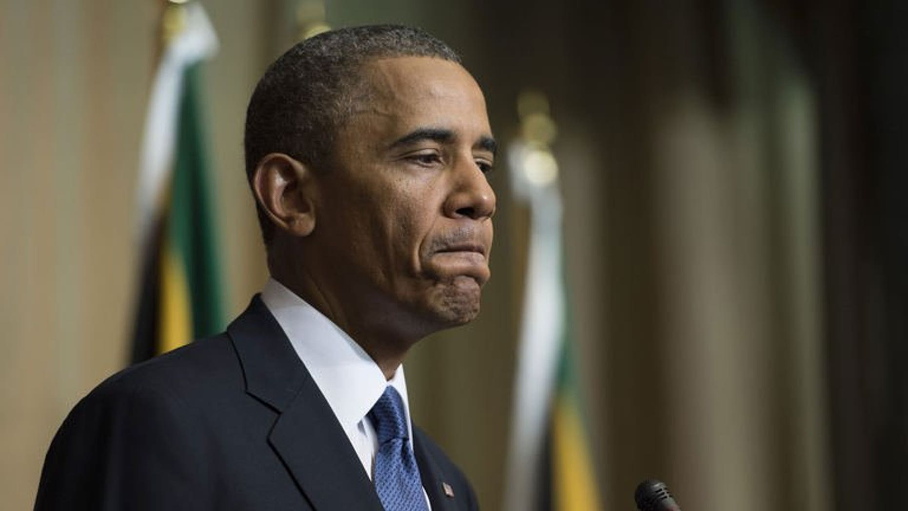 """US President Barack Obama addresses a news conference in Pretoria, South Africa, June 29, 2013. Obama has said the """"timing was not right"""" for him to travel to Kenya, his father's homeland, during his current Africa tour, but he expected to go there many times in the future."""
