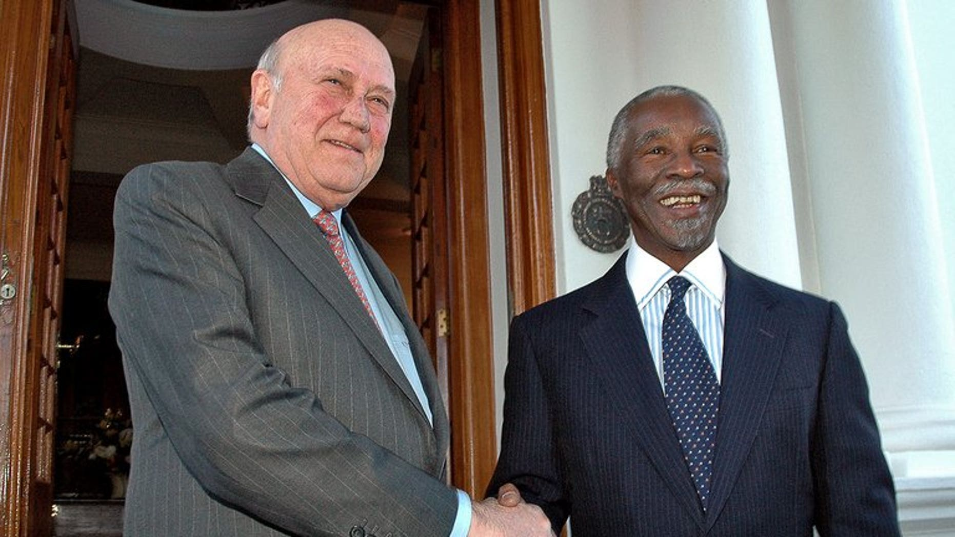 Former South African President FW De Klerk (left) is pictured with then president Thabo Mbeki in Pretoria on 22 May 2007. De Klerk will cut short a visit to Europe because of the ailing health of his co-Nobel prize winner Nelson Mandela, his foundation said.