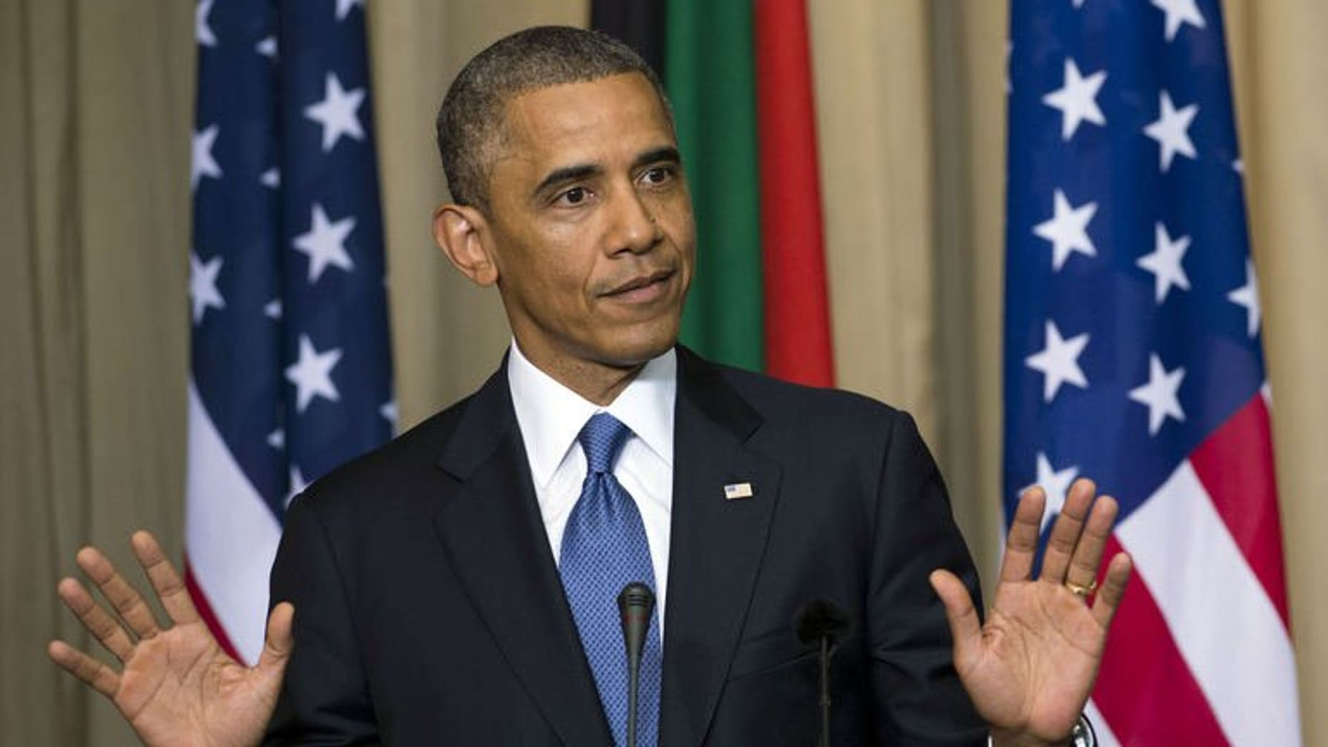 US President Barack Obama addresses a news conference in Pretoria, South Africa, on June 29, 2013. Obama has urged Africans to ask more questions about lop-sided deals with some foreign investors, while dismissing talk of a Chinese and US scramble for influence on the continent.