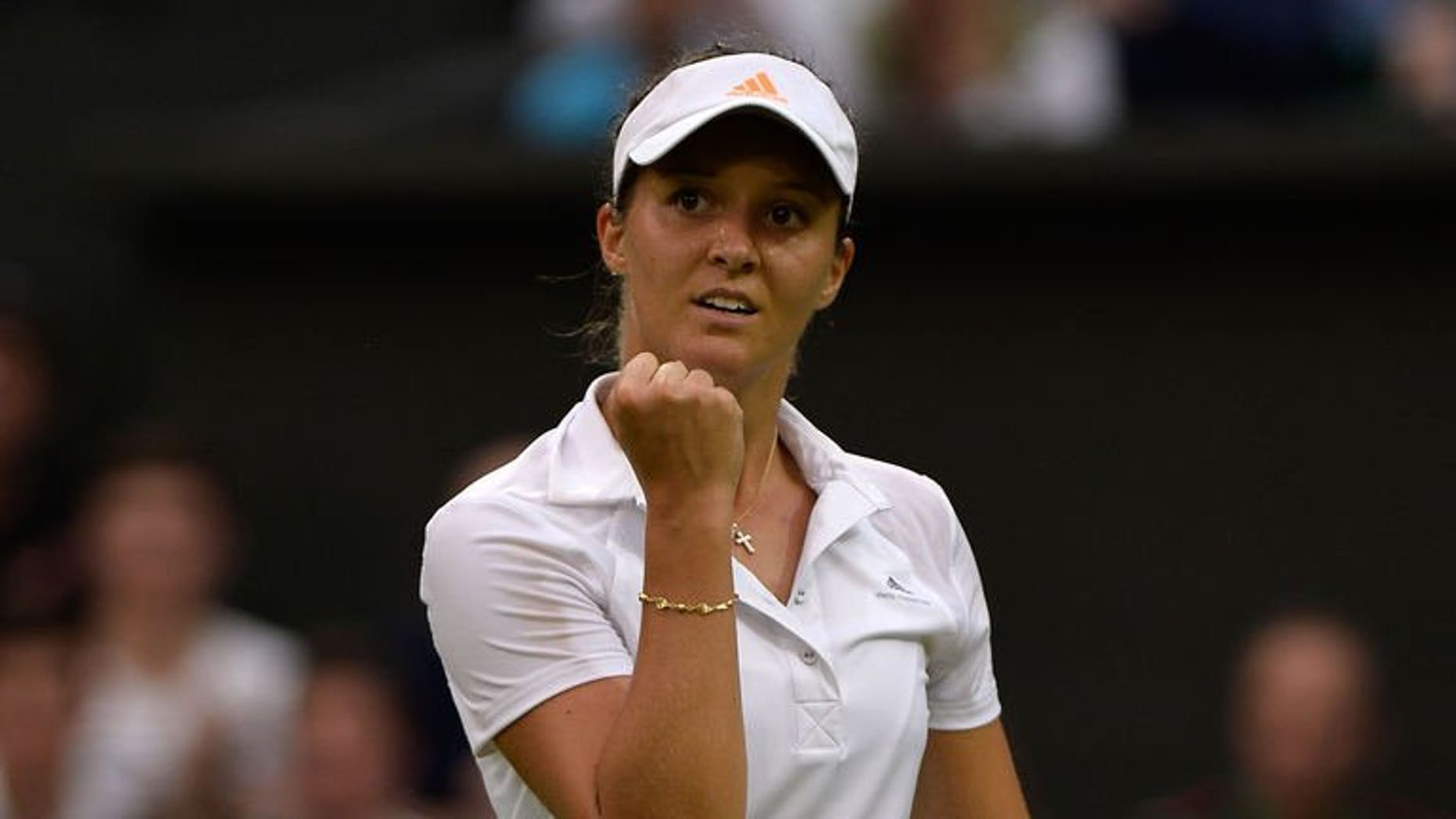 Britain's Laura Robson celebrates reaching match point against Colombia's Mariana Duque-Marino during their second round Wimbledon match on June 28, 2013. Robson won 6-4, 6-1 to become the first British woman to reach the Wimbledon fourth round in 15 years.
