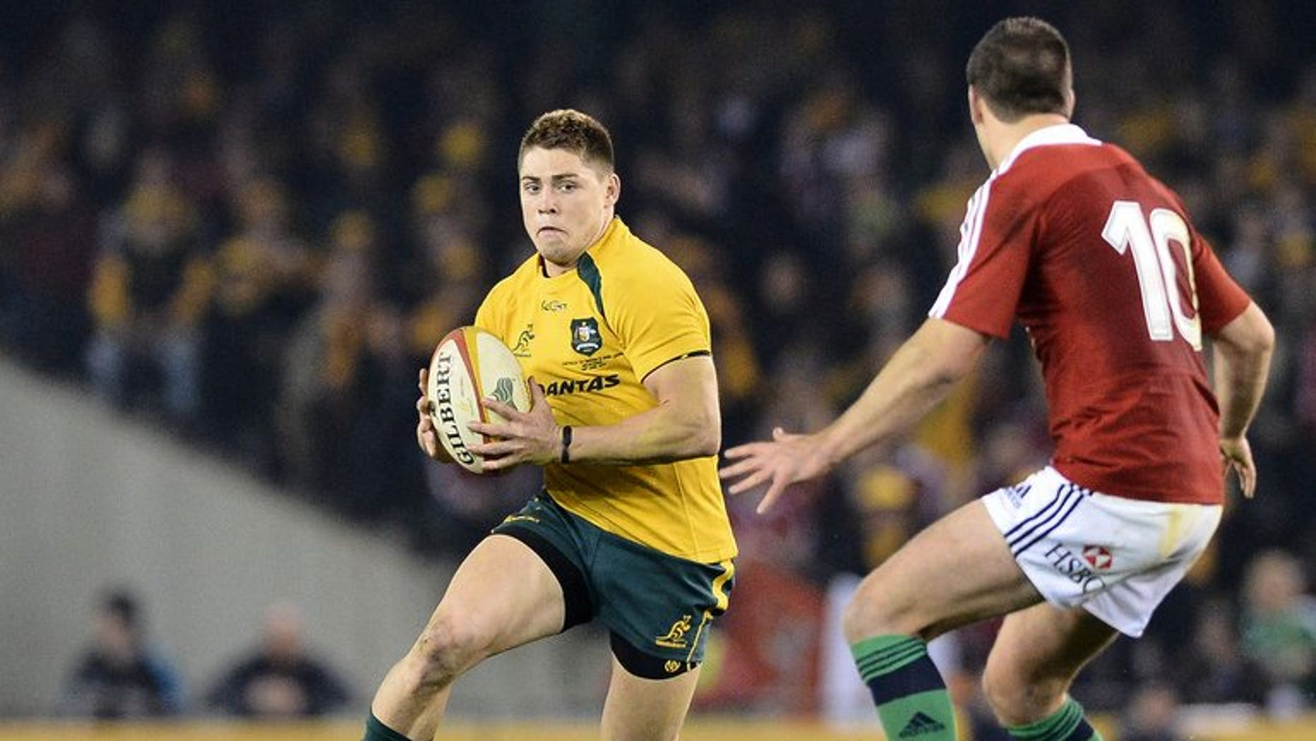 James O'Connor of Australia runs with the ball during the second Test against the British and Irish Lions on June 29, 2013. Australia won the match 16-15.