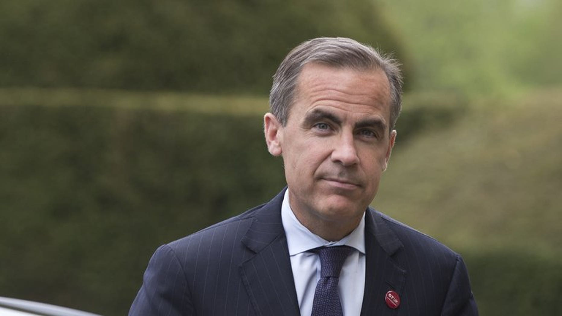 Canadian Mark Carney, pictured in May, 2013, begins his job as governor of the Bank of England on Monday, joining an institution divided on whether to pump out more cash stimulus to boost Britain's fragile economic recovery