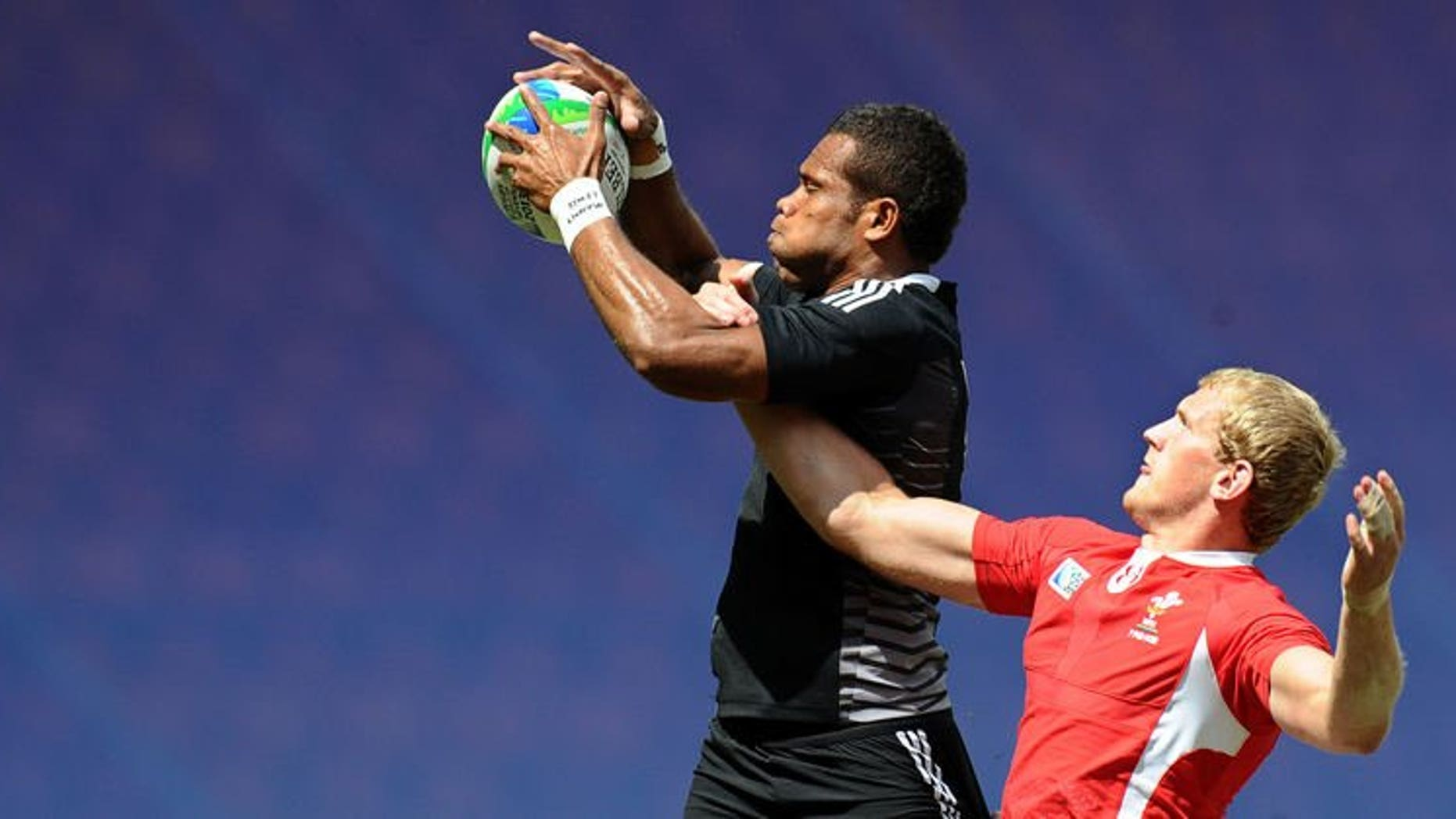 James Davies (right) of Wales vies with Tomasi Cama of New Zealand during their quarter final match at the 2013 Rugby World Cup Sevens in Moscow on June 30, 2013. New Zealand knocked defending champions Wales out of the tournament to set up a semi-final against arch-rivals Fiji.