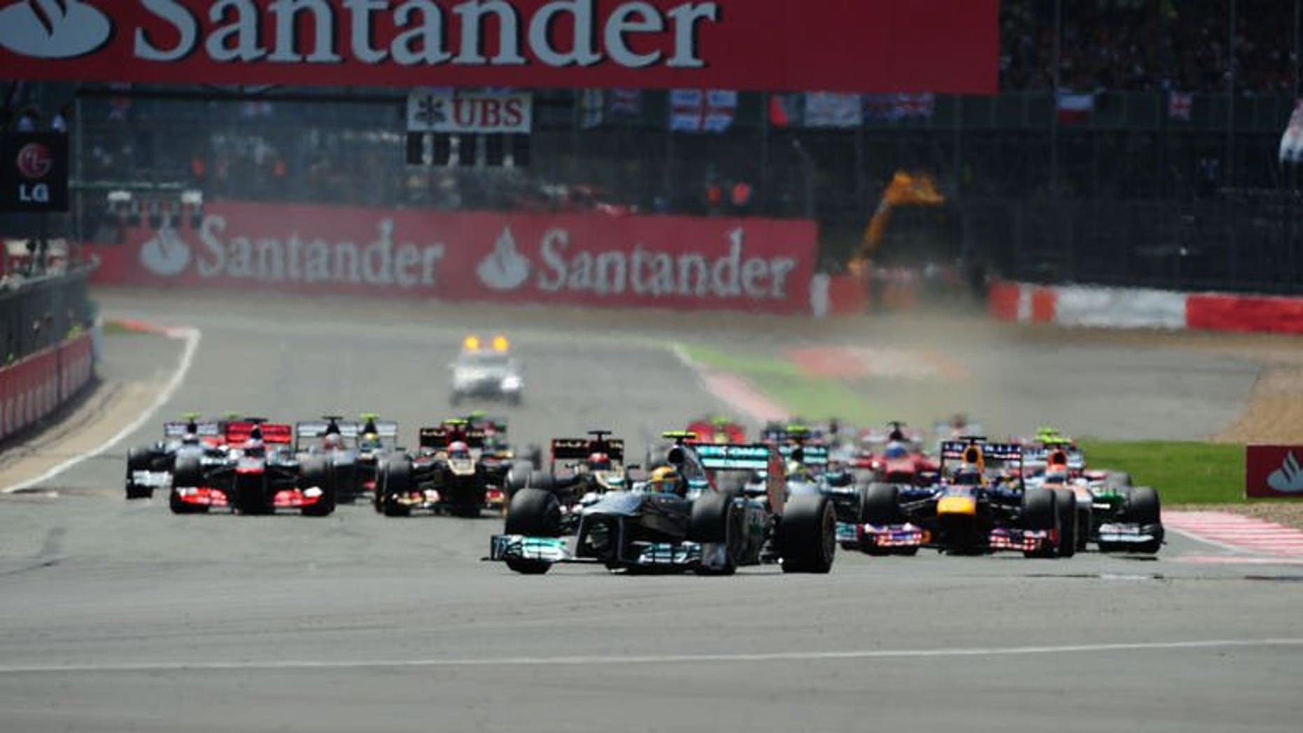 Mercedes' British driver Lewis Hamilton leads after the start at the Silverstone circuit in Silverstone on June 30, 2013 during the British Formula One Grand Prix. Hamilton's hopes of his second win in the British Grand Prix looked to have been fatally damaged as his left rear tyre deflated in spectacular fashion.