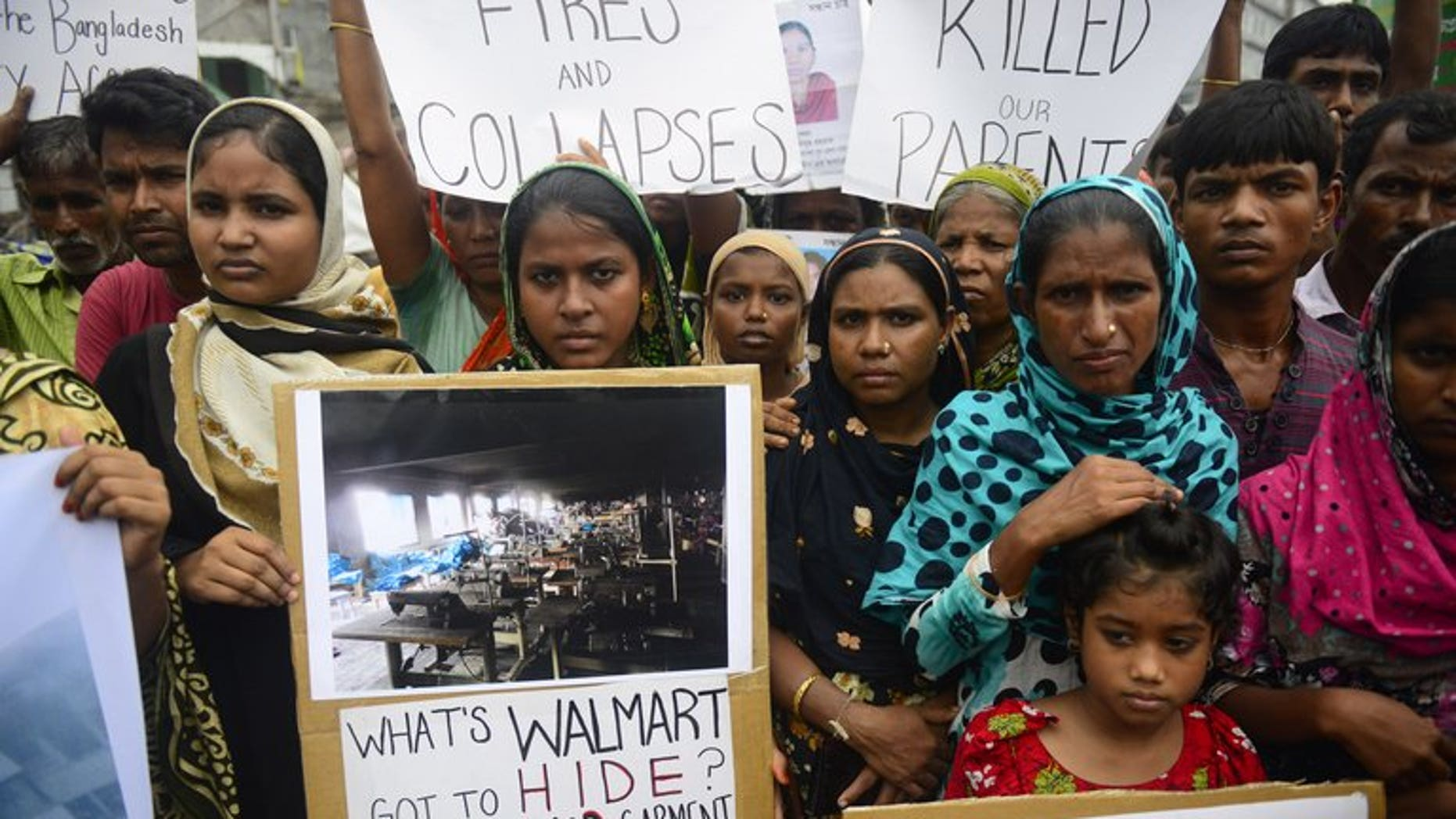 Relatives of workers who lost their lives in a garment factory disaster rally in Savar near Dhaka on Saturday. About 450 employees fell ill on Sunday after complaining of contaminated water at their workplace near the Bangladeshi capital, the second such incident to hit the same garment factory in recent days, police said.