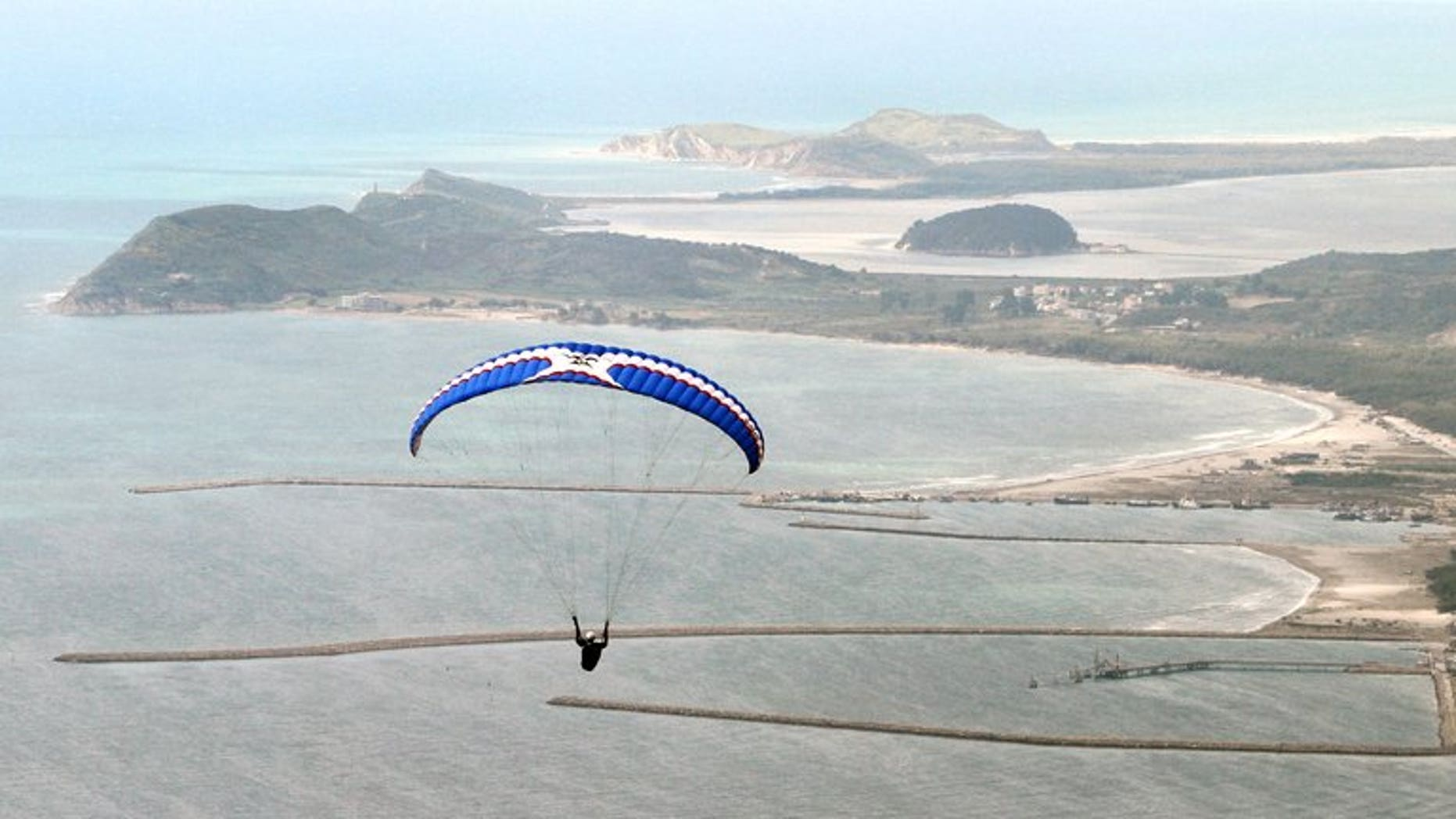 A paraglider flies over the shores of Albanian coastal town of Vlora. Iran on Sunday confirmed the arrest of several Slovaks two days after Bratislava announced that a group of paragliders had been apprehended, reportedly accused of espionage.