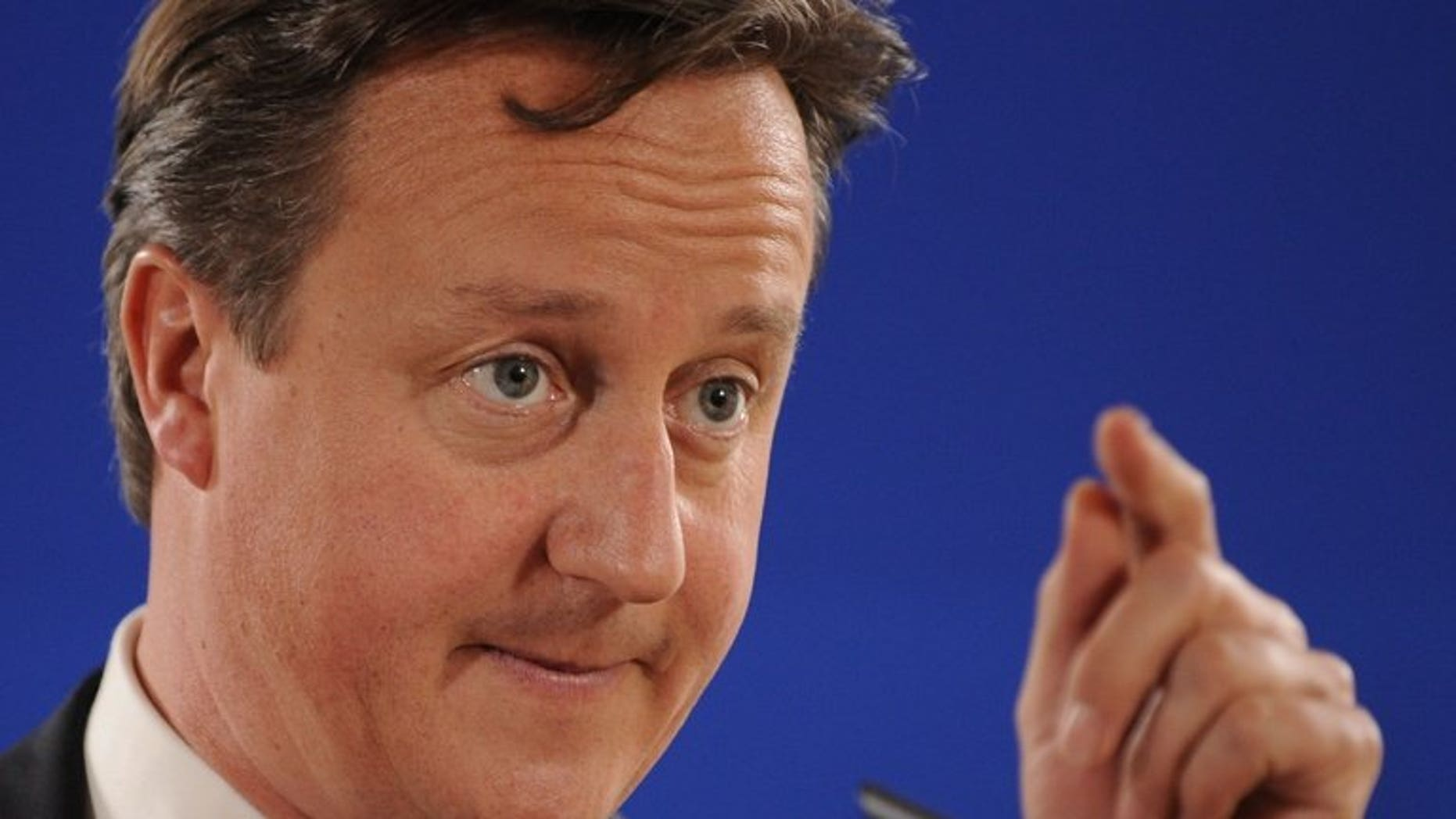 British Prime Minister David Cameron attends a news conference in Brussels on June 28, 2013. Cameron arrived in Kazakhstan on the first ever trip by a serving British prime minister, hoping to boost trade ties but also promising to raise human rights concerns.