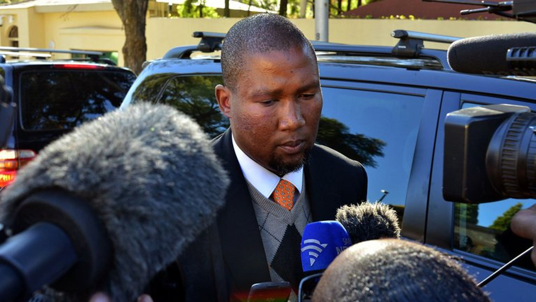 Mandla Mandela addresses the media in Johannesburg on June 12, 2013. A bitter feud within Nelson Mandela's family over the final resting place of the ailing anti-apartheid hero and his children intensified Sunday, with his grandson Mandla lamenting the dispute has been taken to court.
