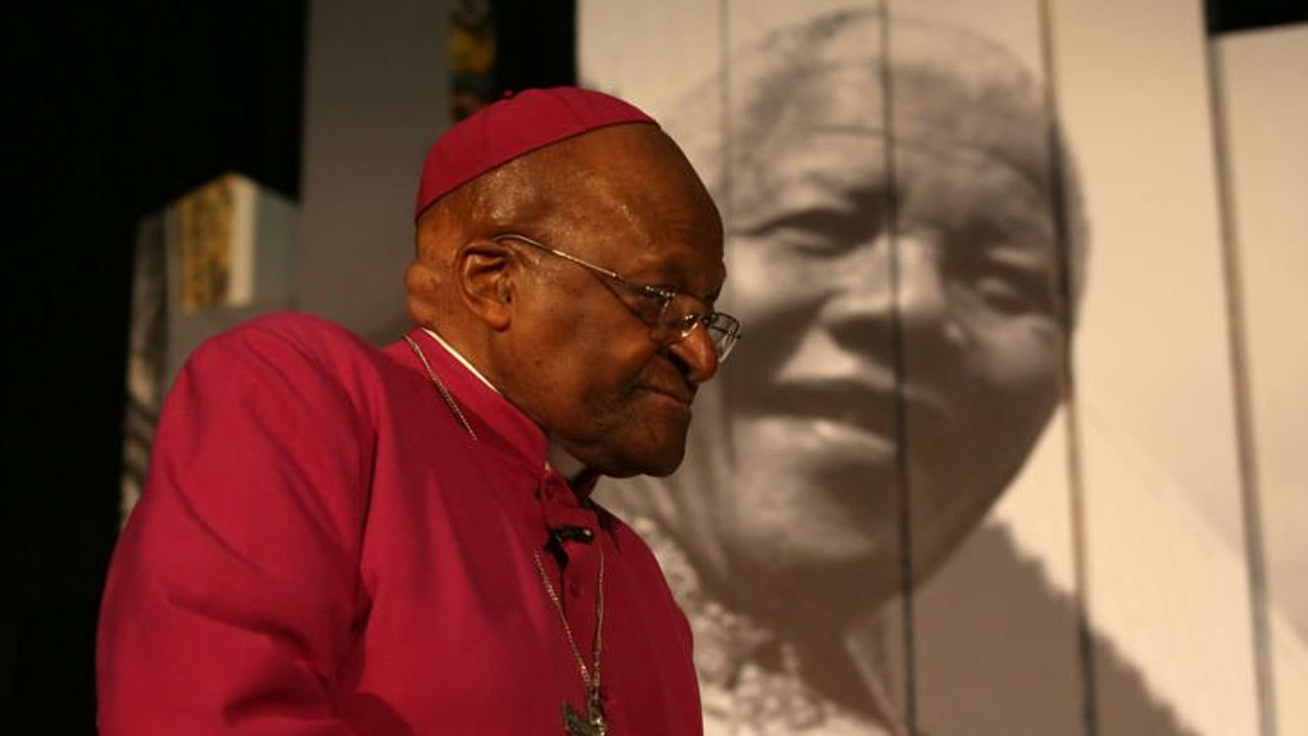 """Archbishop Desmond Tutu attends the launch of Cape Town's Nelson Mandela Legacy Exhibition at the Civic Centre on June 30, 2013. Tutu on Sunday hailed Mandela as an """"incredible, incredible person"""" who was still uniting South Africans from the hospital bed where he is battling for his life."""