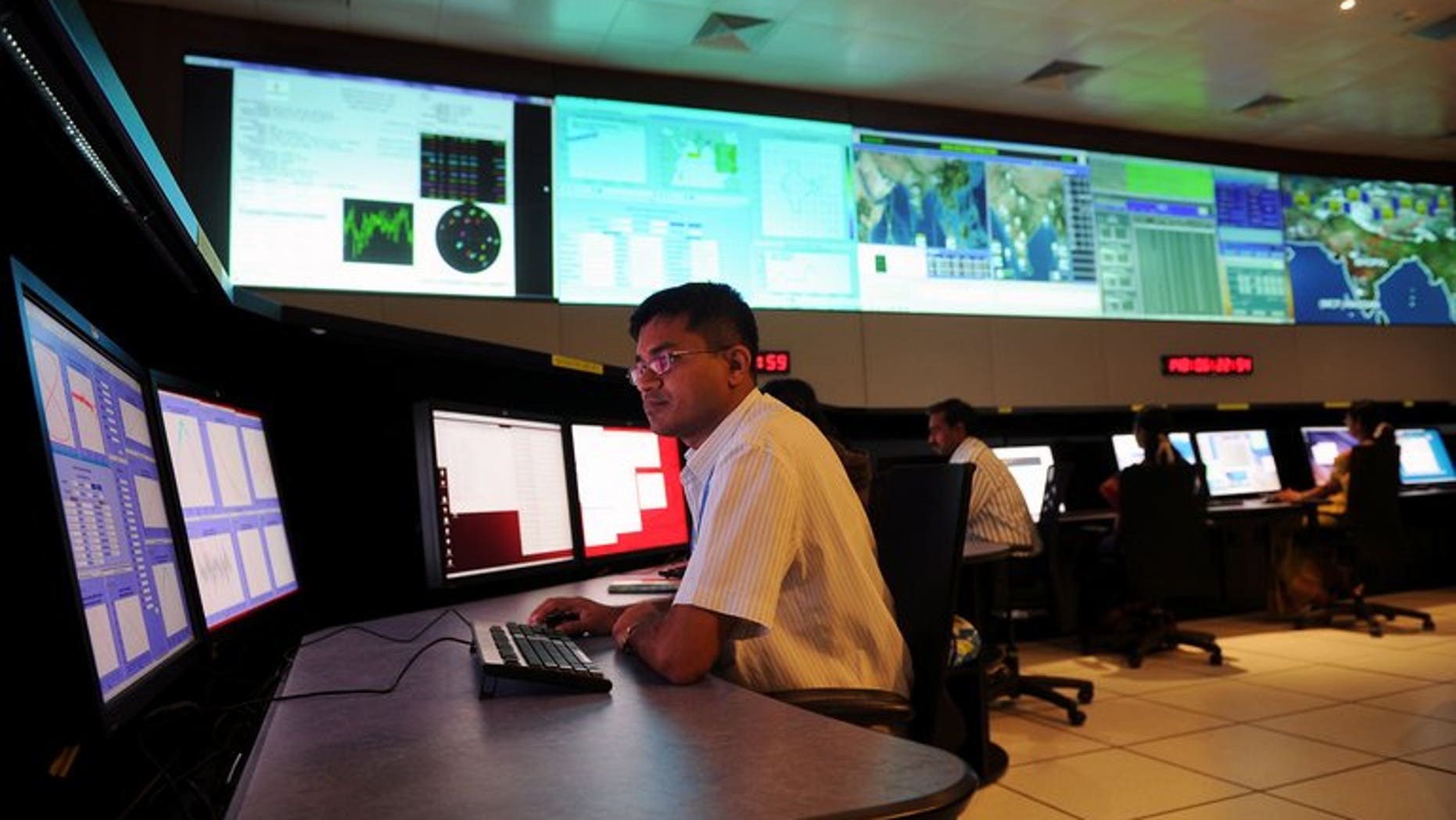 Scientists from the Indian Space Research Organisation (ISRO) work in the Indian Regional Navigational Satellite System (IRNSS) control room, at the Indian Deep Space Network (IDSN), in Byalalu village, about 50 km from Bangalore, on May 28, 2013. India will on Monday launch the first stage of IRNSS which will eventually provide services both to civilians and the military.