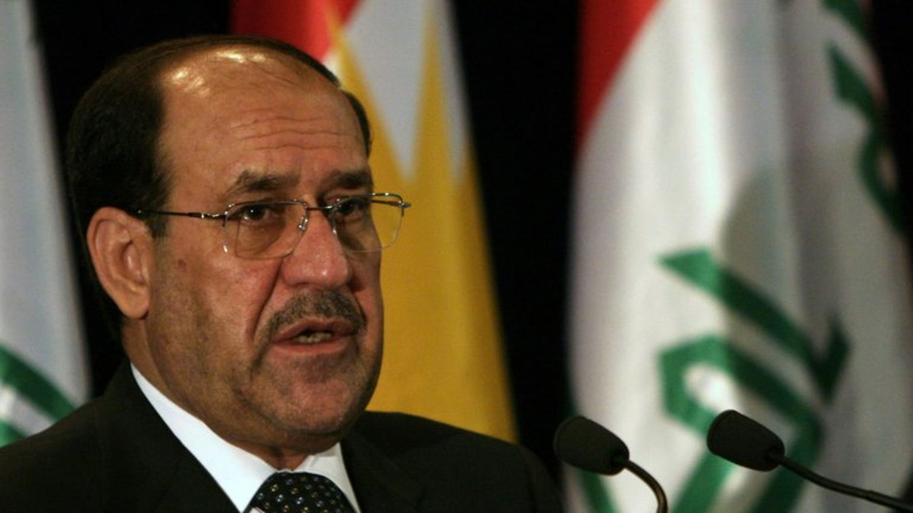 Iraqi Prime Minister Nuri al-Maliki speaks during a joint press conference in Arbil, on June 9, 2013. Maliki has held talks in Moscow with the Russian oil company Lukoil about enacting an existing energy contract and possible participation in future deals, Lukoil said.