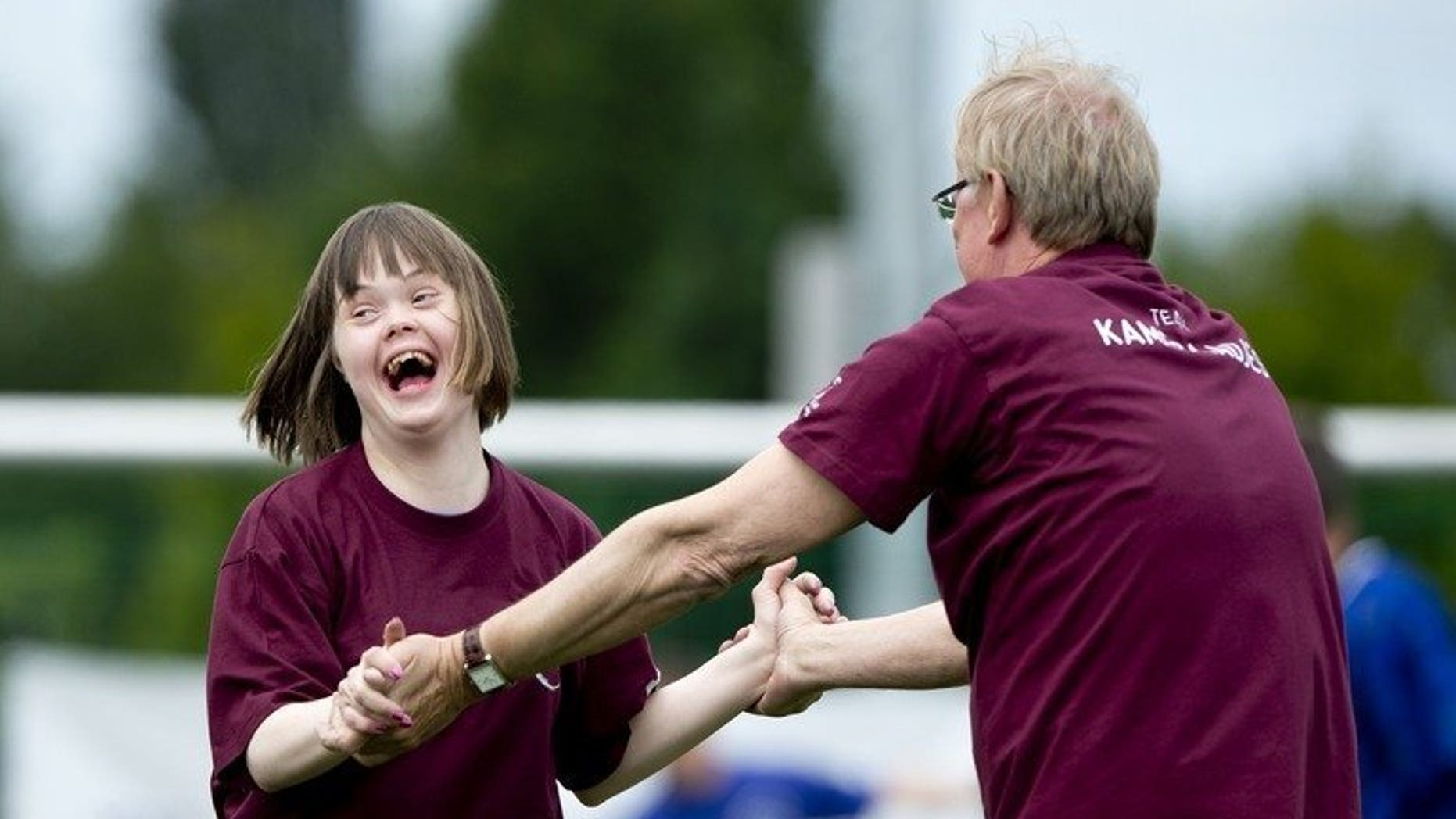 A child with Down's syndrome shares a laugh with Netherlands' TV presenter Jack Spijkerman as they take part in the 'Give Down the Future' football tournament in De Toekomst stadium in Amsterdam on June 29, 2013. A Japanese pharmaceutical company said Monday it will begin therapeutic testing of a drug it hopes will slow the decline in quality of life for some people with Down's syndrome.