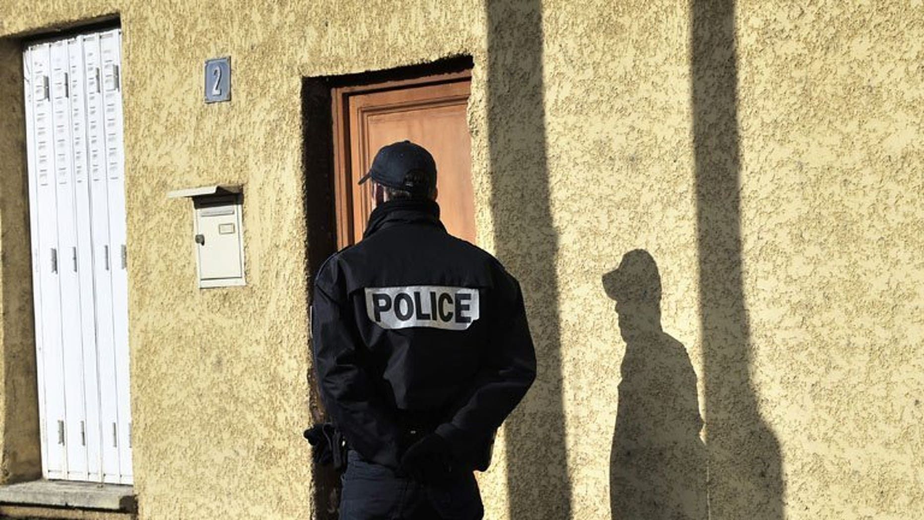 A French policeman patrols the streets of Decines-Charpieu, on April 11, 2012. Robbers posing as policemen made off with 200,000 euros ($261,000) belonging to a senior official from the Saudi youth and sports ministry just after he landed in Paris, police said Monday.