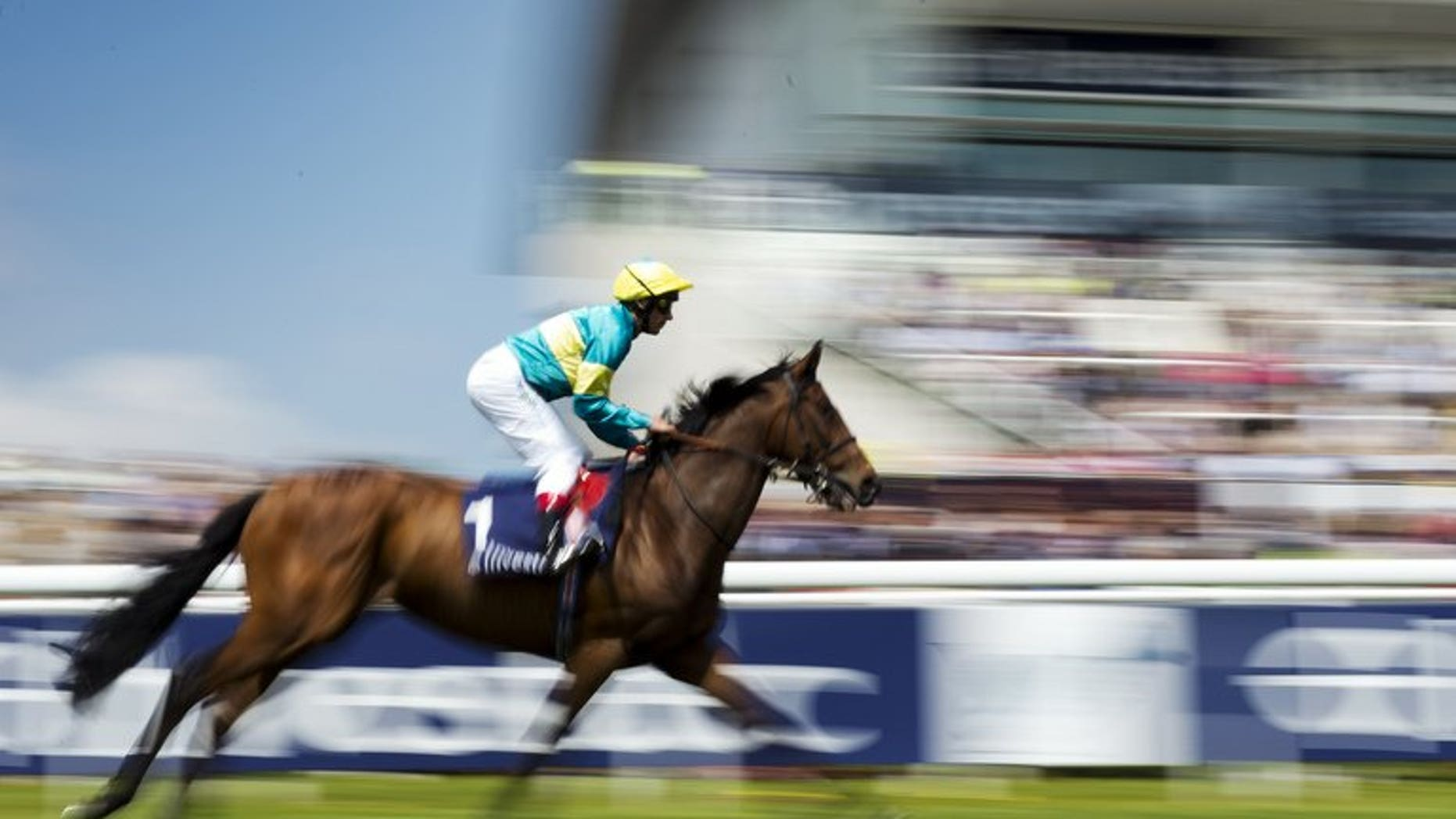Frankie Dettori rides Fattsota at Epsom on May 31. Dettori on Monday signed a contract to ride for emerging Qatari owner Sheikh Joaan al-Thani, the Racing Post newspaper reported.