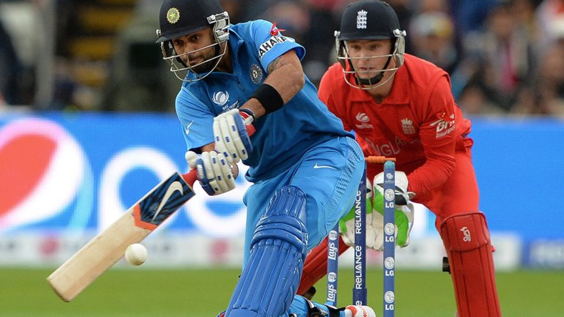 Virat Kohli hits a six for India against England in the Champions Trophy final at Edgbaston on June 23. India and Sri Lanka go in search of their first points of the Tri-Nation Series when they meet on Tuesday at Sabina Park as the preliminary phase of the competition reaches the halfway point.