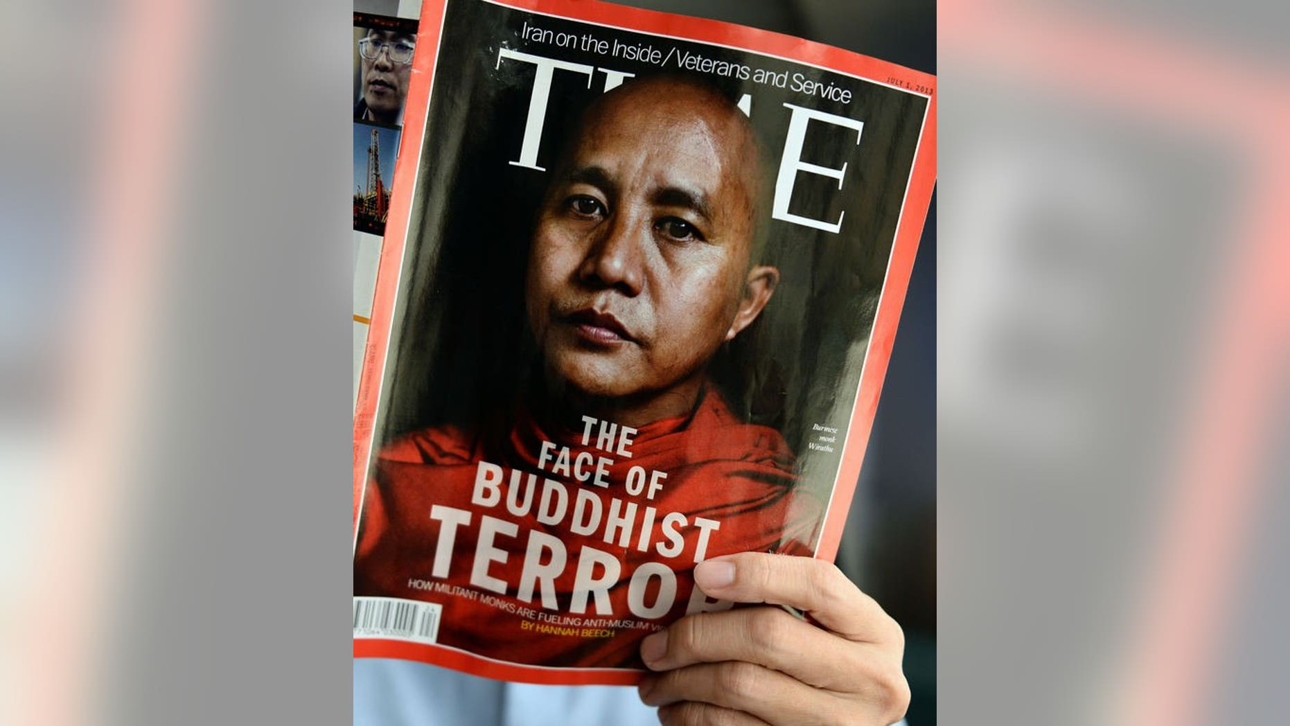 A man is seen reading a copy of the July 1 issue of Time magazine, carrying a picture of controversial Myanmar monk Wirathu on its cover, in Bangkok, on June 24, 2013. Sri Lanka has banned the issue over its cover story on Myanmar's Buddhist-Muslim clashes, which it said could hurt religious sentiment on the island, an official said on Tuesday.