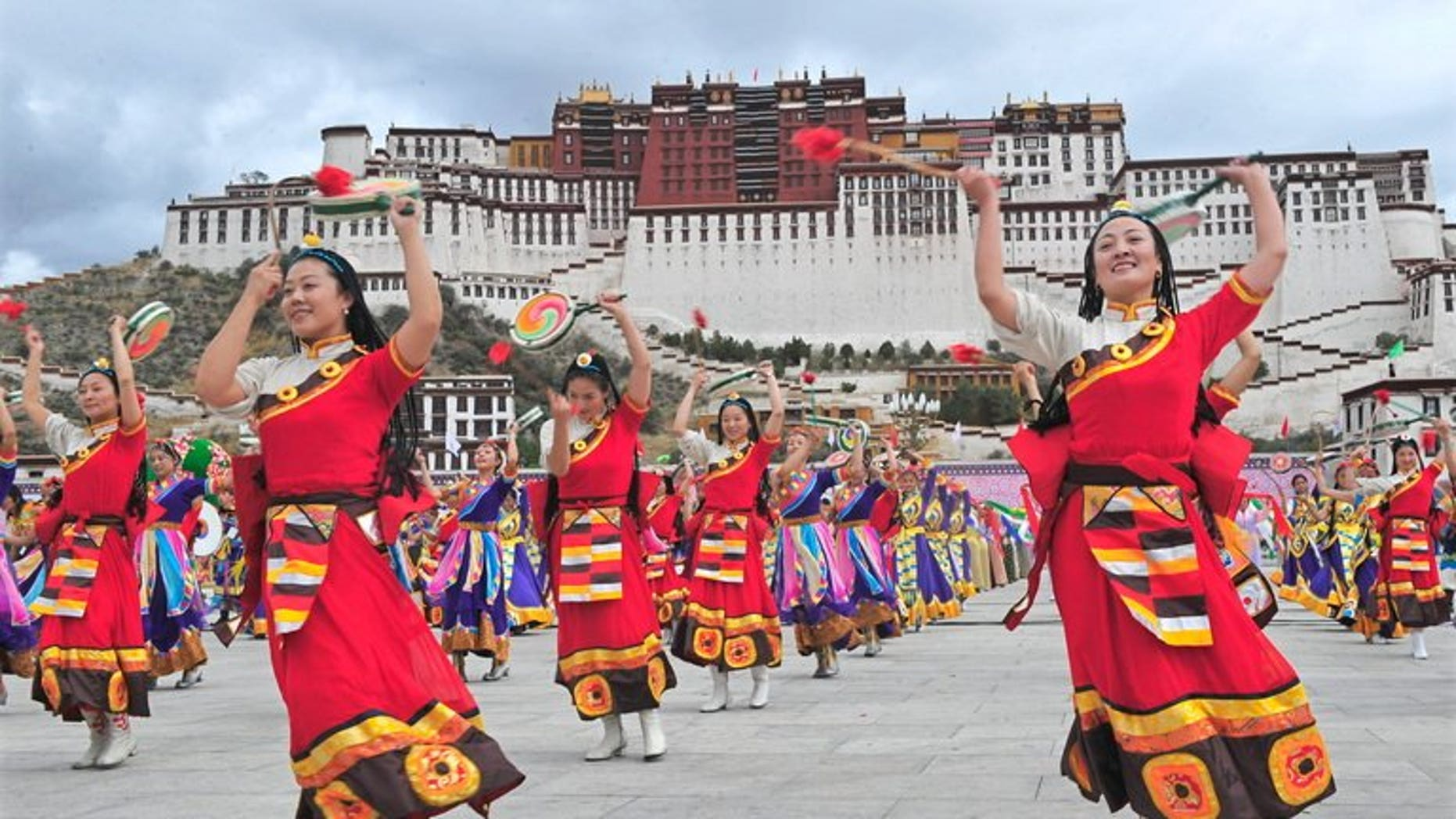 Tibetan performers dressed in traditional costume perform in Lhasa on June 21, 2008. The controversial renovation of the historic area around a key monastery in the Tibetan capital has been completed, Chinese state media said.