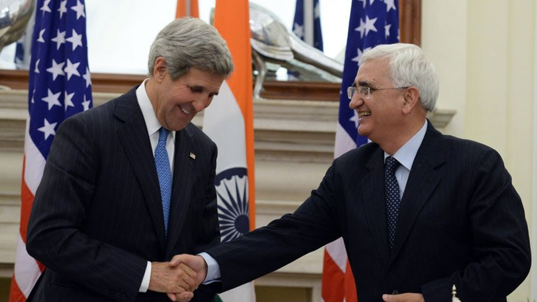 US Secretary of State John Kerry (L) shakes hands with India's foreign minister, Salman Khurshid, after a press conference in New Delhi, on June 24, 2013. Khurshid on Tuesday defended the vast US surveillance programme of phone logs and Internet data revealed by intelligence leaker Edward Snowden.