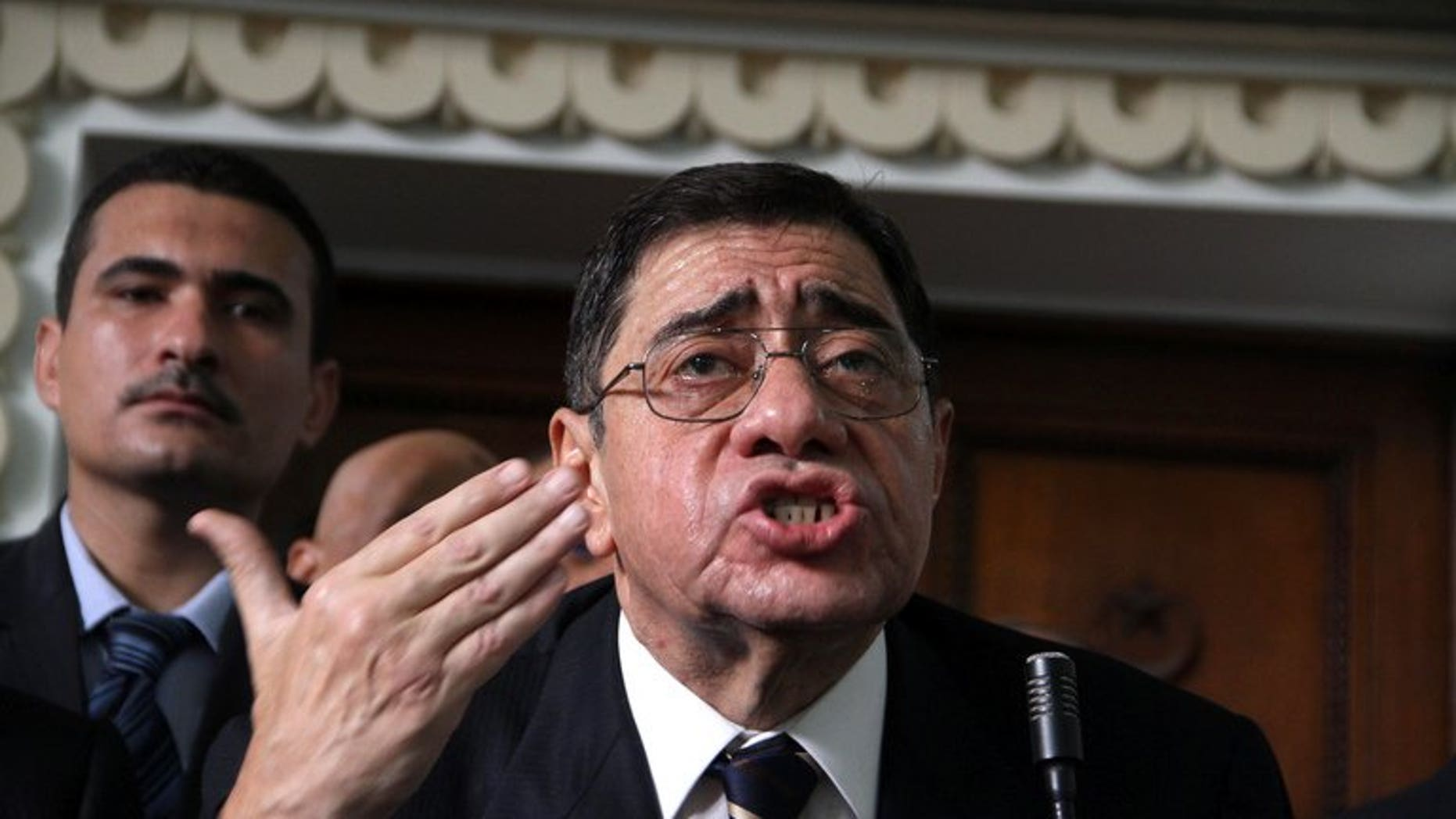 Egyptian public prosecutor Abdel Meguid Mahmud addresses judges at the High Court in Cairo, on October 13, 2012. An Egyptian court has ordered the reinstatement of Mahmud, whose sacking in November sparked a bitter row between President Mohamed Morsi and the judiciary.