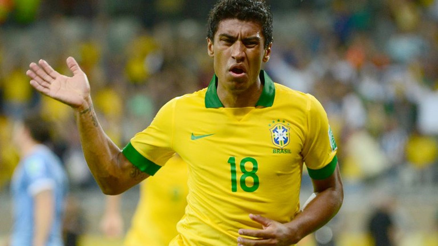 Brazil's Paulinho celebrates after scoring against Uruguay during their Confederations Cup semi-final match in Belo Horizonte, on June 26, 2013. Paulinho has announced he is leaving Corinthians for English Premier League side Tottenham Hotspur.