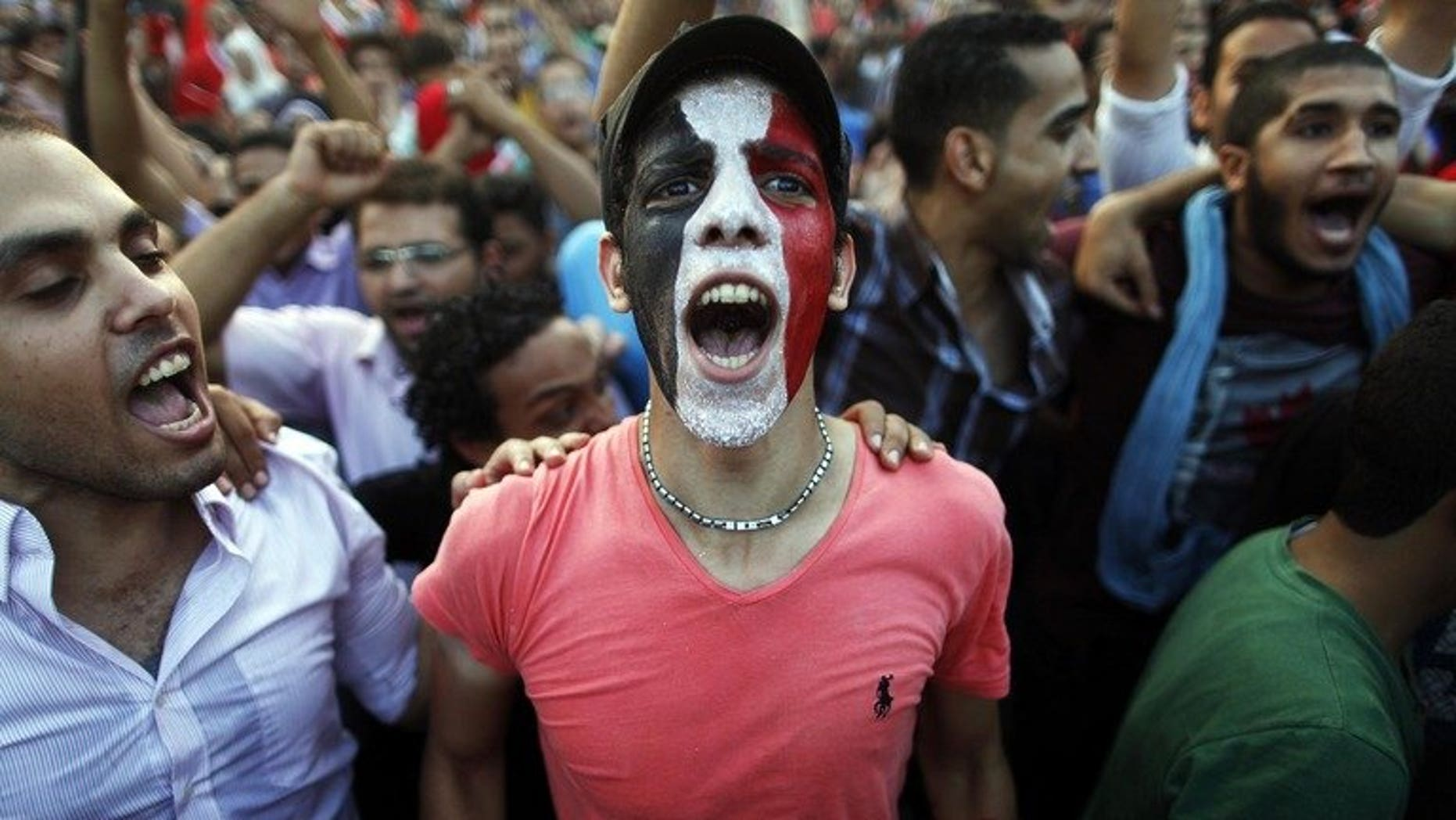 "Egyptians shout slogans against President Mohamed Morsi and the Muslim Brotherhood during a demonstration in Cairo, on July 1, 2013. Egypt's main opposition coalition says it would not support a ""military coup"" and trusted that an army statement giving political leaders 48 hours to resolve the current crisis did not mean it would assume a political role."