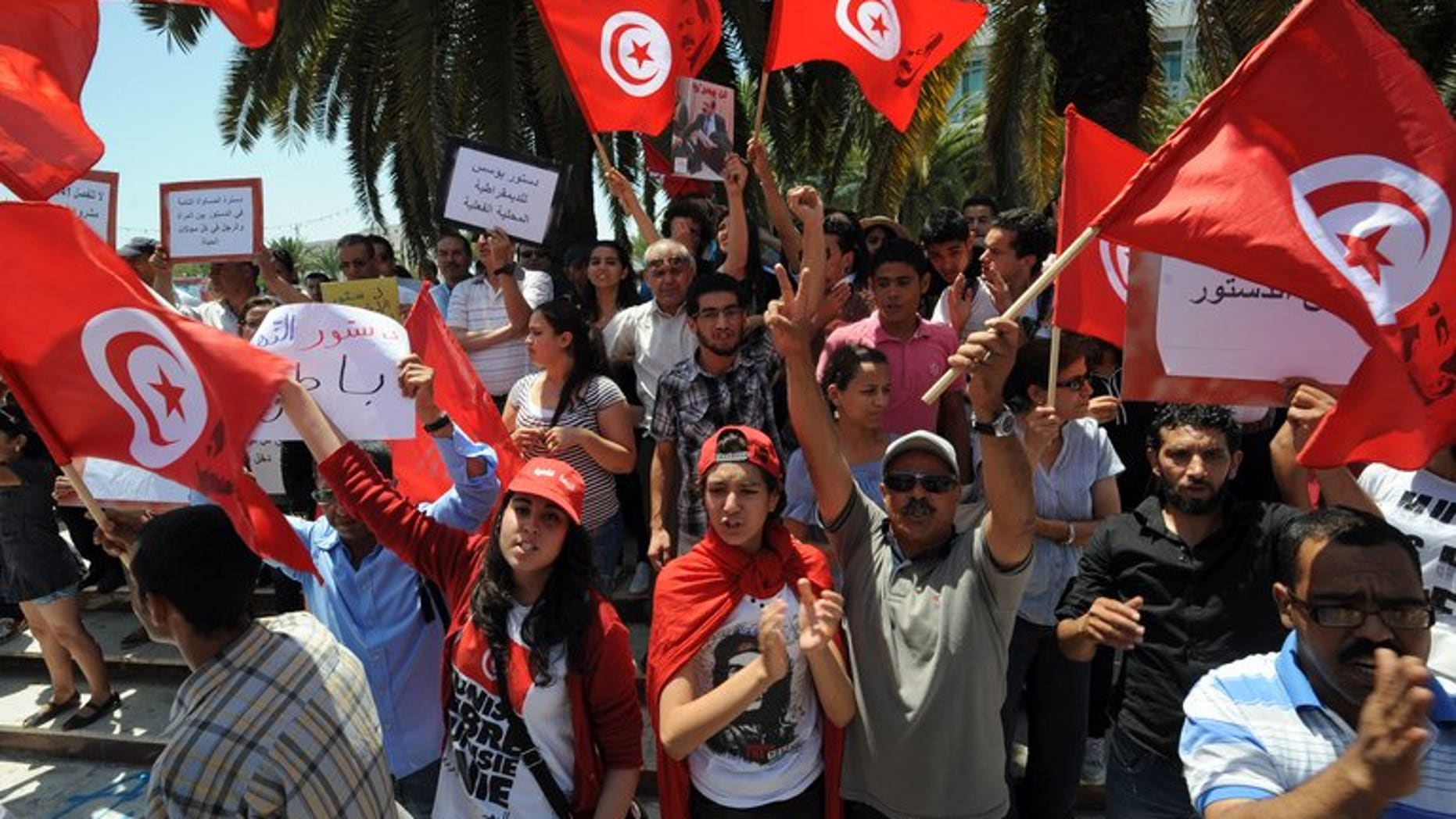 Tunisians shout slogans against the ruling Ennahda Party during a protest in front of the Constituent Assembly on July 1, 2013 in Tunis. Troubled French automaker PSA Peugeot Citroen on Tuesday opened a new plant in central China, vowing to raise its share of the world's biggest car market.