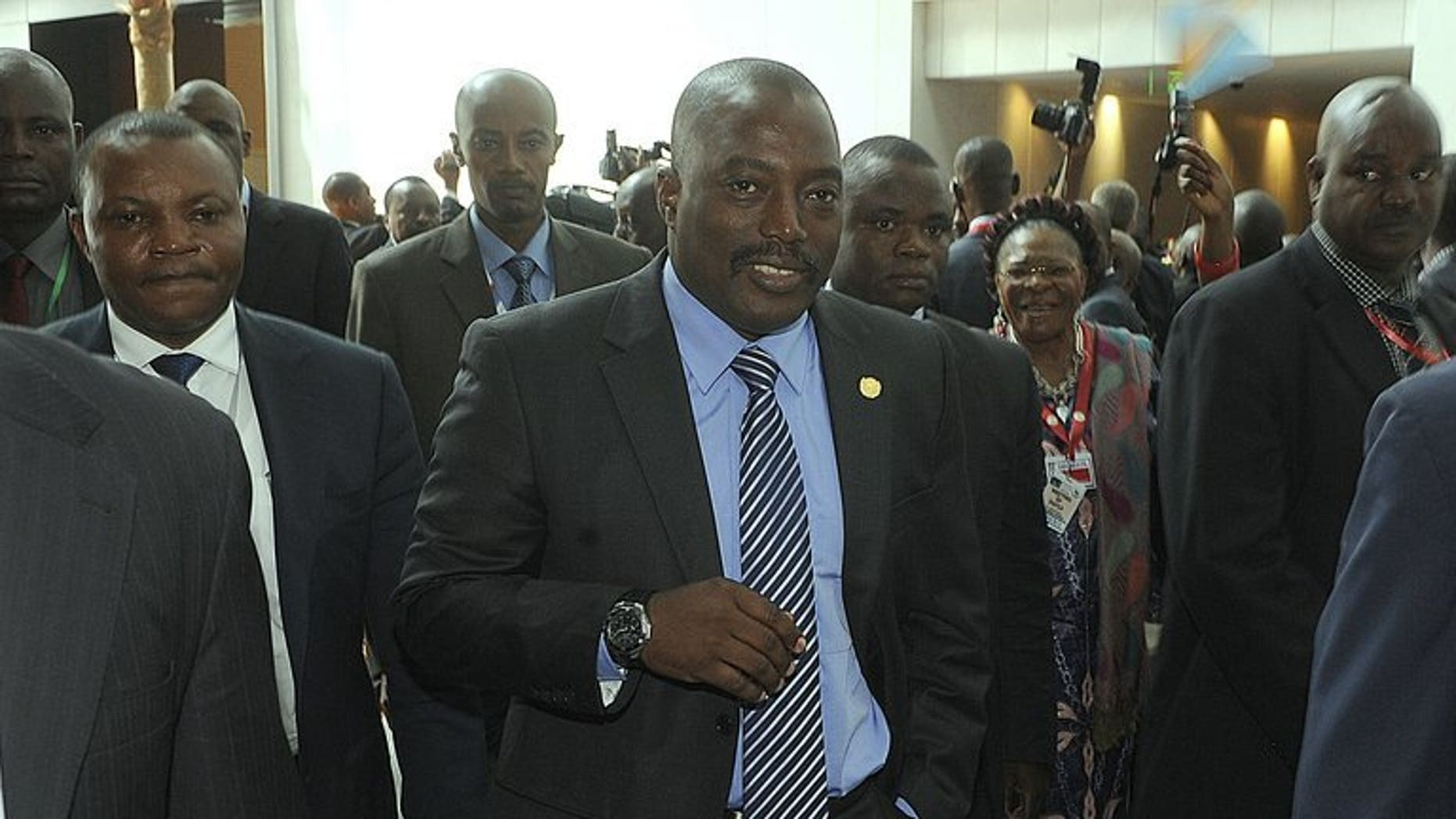 """DR Congo President Joseph Kabila (C), seen at the 50th African Union Anniversary Summit in Addis Ababa on May 26, 20113. Opposition parties in the DR Congo have rejected an offer of """"national consultations"""" made by Kabila, they said in a joint statement."""