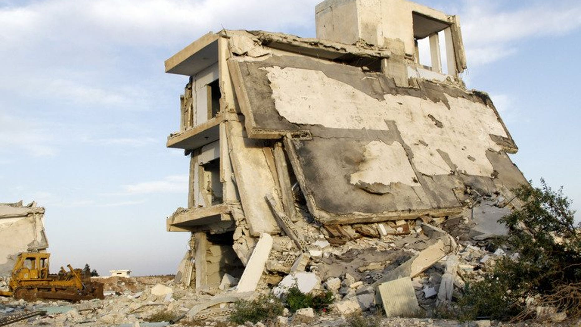 "Destroyed buildings in the village of al-Hamidiyeh, in central Homs province, on June 7, 2013. UN leader Ban Ki-moon has expressed fear for 2,500 ""trapped"" civilians as Syrian government forces press a campaign to take the city of Homs, a spokesman said."