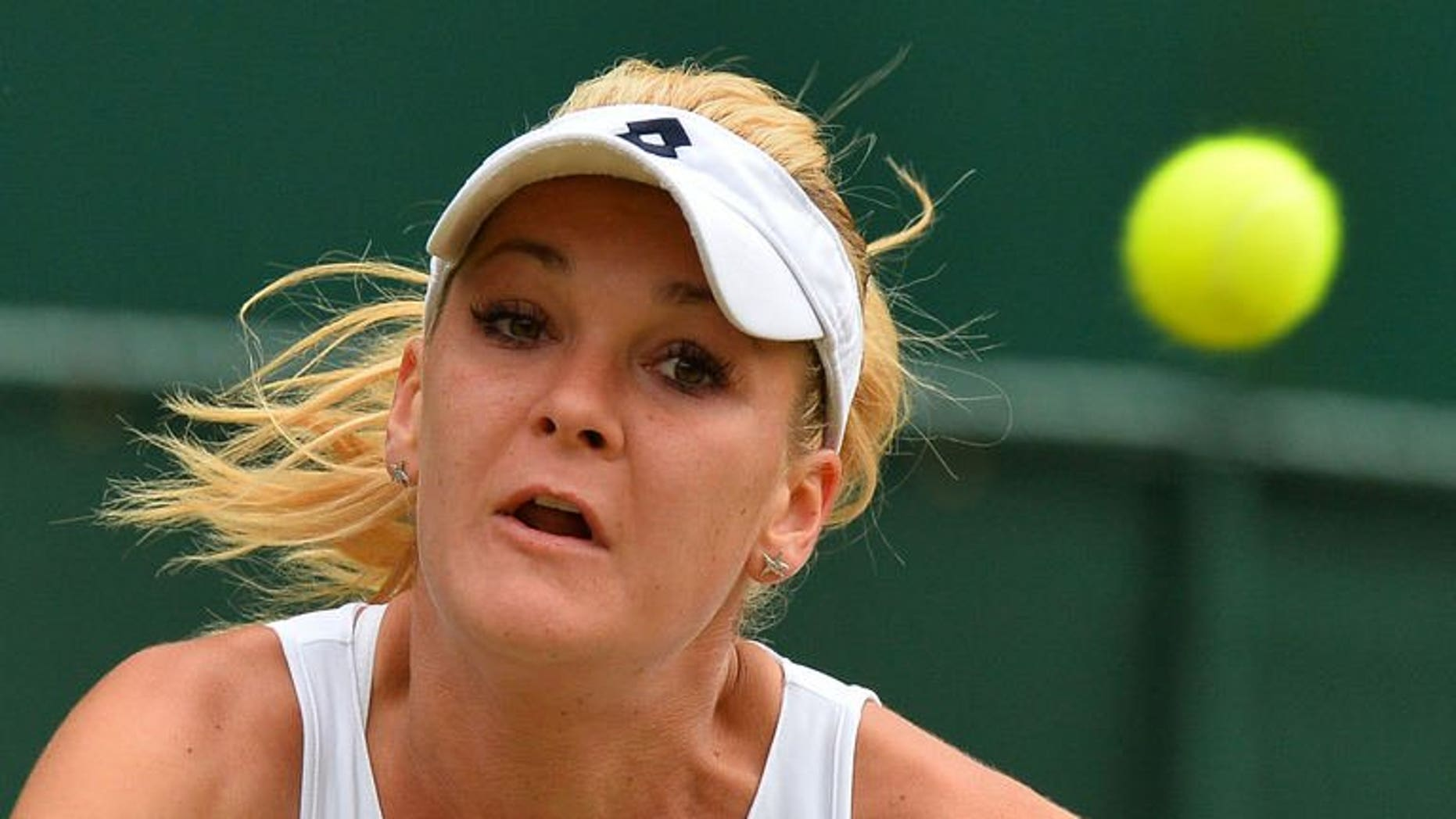 Poland's Agnieszka Radwanska eyes a return against China's Li Na during their quarter-final match at the Wimbledon Championships in southwest London, on July 2, 2013. Radwanska won 7-6 (7/5), 4-6, 6-2 in a two-hour, 43 minute contest on Centre Court.
