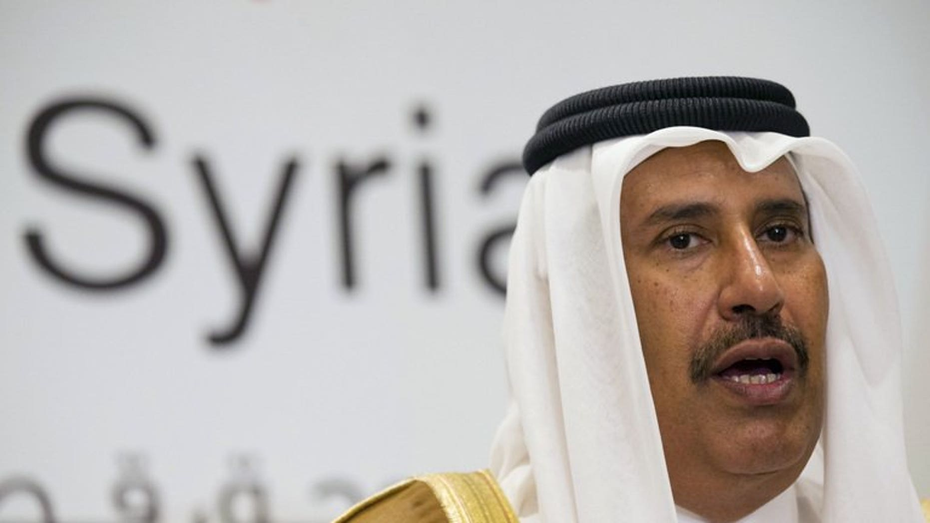 Qatari former prime minister and foreign minister Hamad bin Jassim al-Thani, speaks at a news conference on June 22, 2013. The former prime minister and strongman was Tuesday replaced as deputy head of the powerful Qatar Investment Authority in a shakeup ordered by the country's new young emir, official QNA news agency reported.