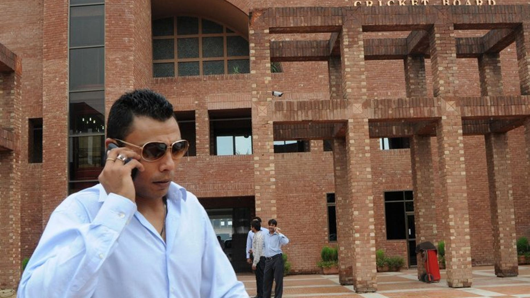"""Danish Kaneria leaves the Gaddafi stadium in Lahore on August 15, 2011. Kaneria was urged to """"come clean"""" after his lifetime ban from cricket remained in place Tuesday when the England and Wales Cricket Board rejected his appeal at a hearing in London."""