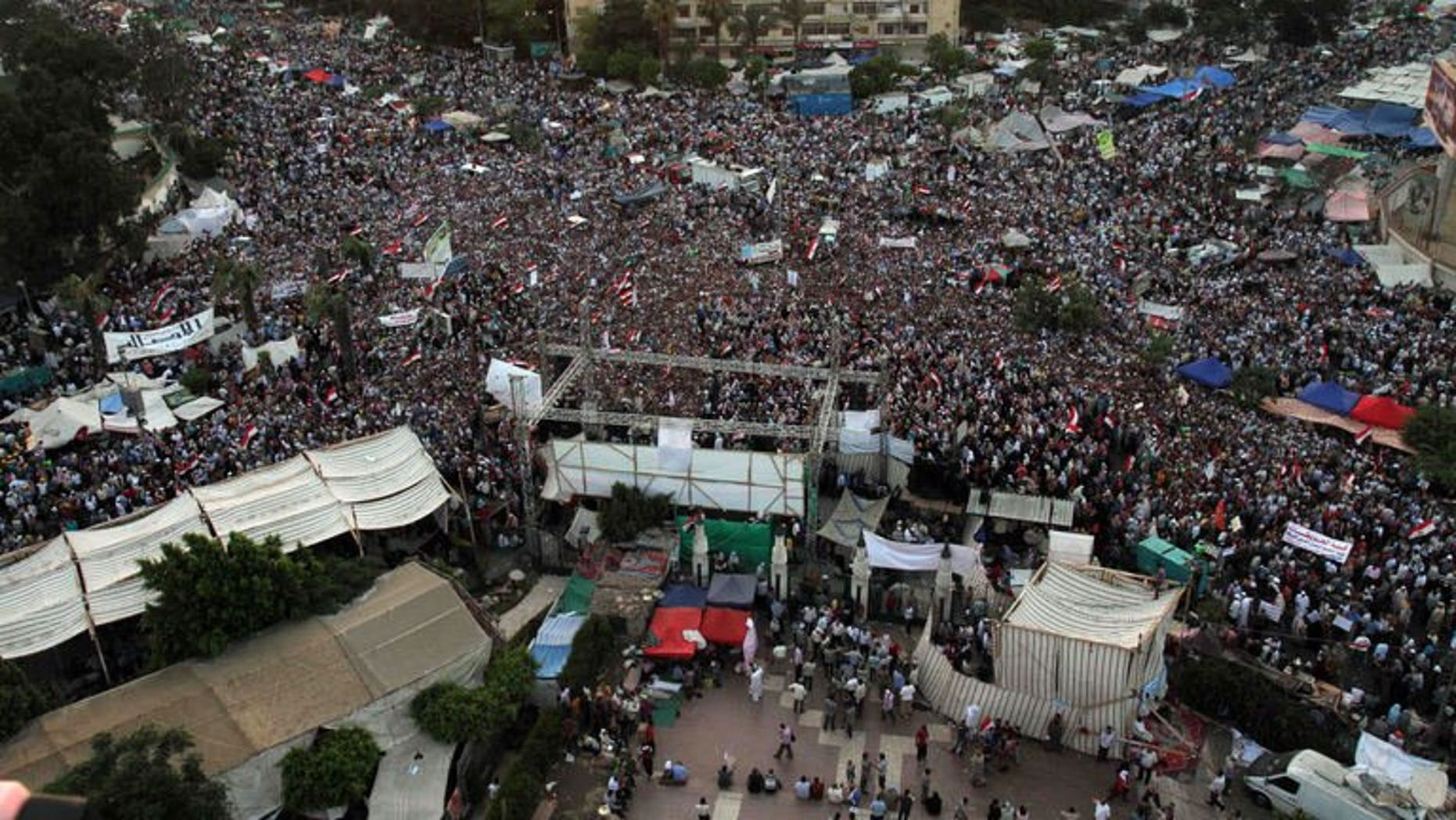 Egyptian supporters of President Mohamed Morsi gather in Rabaa el-Aadawia district of cairo on July 2, 2013. Britain warned its nationals against all but essential travel to most of Egypt after the army threatened to intervene to quell ongoing protests against President Mohamed Morsi.
