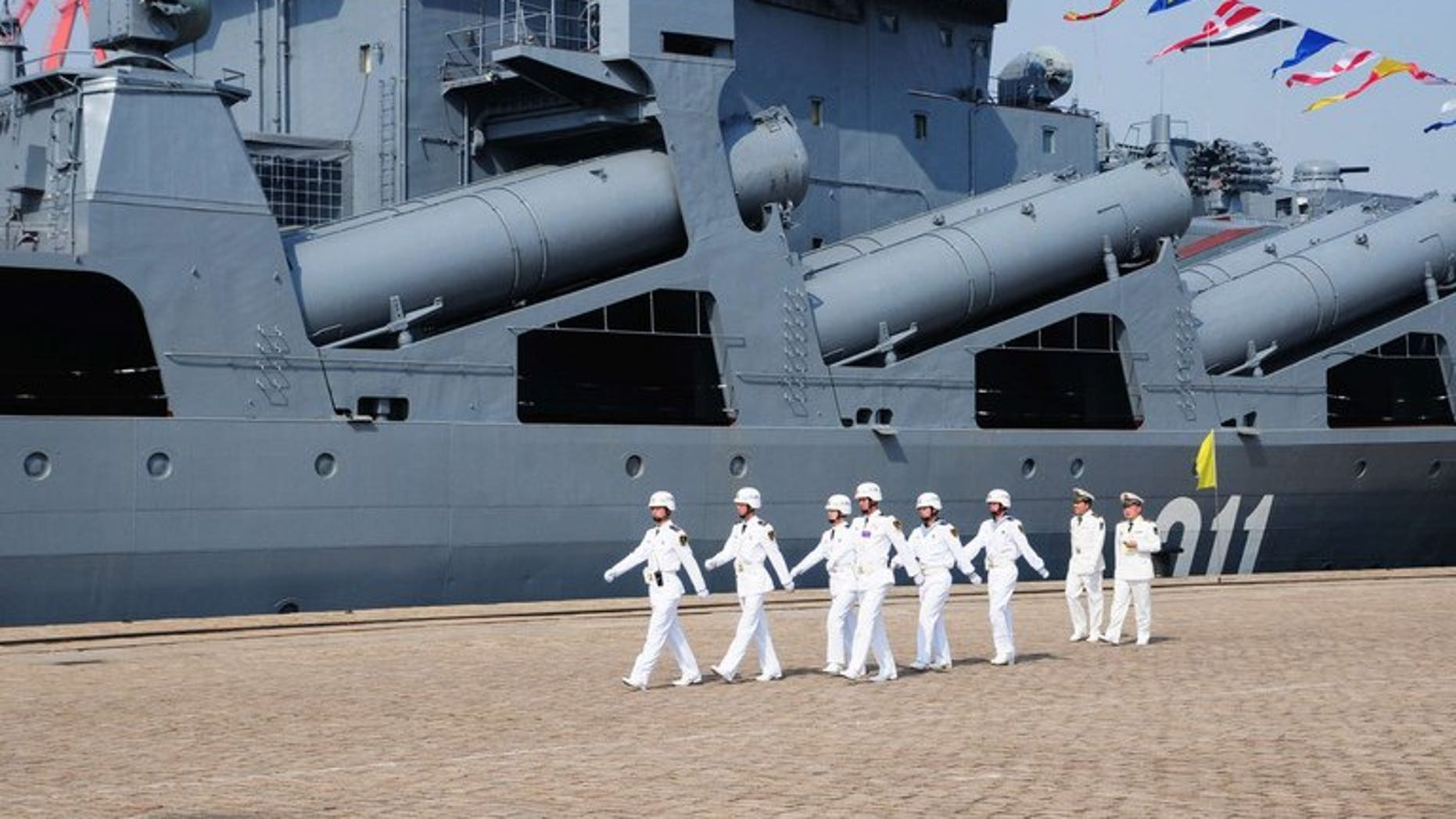 Chinese sailors march past the Russian destroyer Admiral Vinogradov, in Qingdao, northeastern China, on April 23, 2012. China and Russia will hold their second joint naval exercises from Friday, state media said, as Beijing and Tokyo row over disputed islands in the East China Sea.