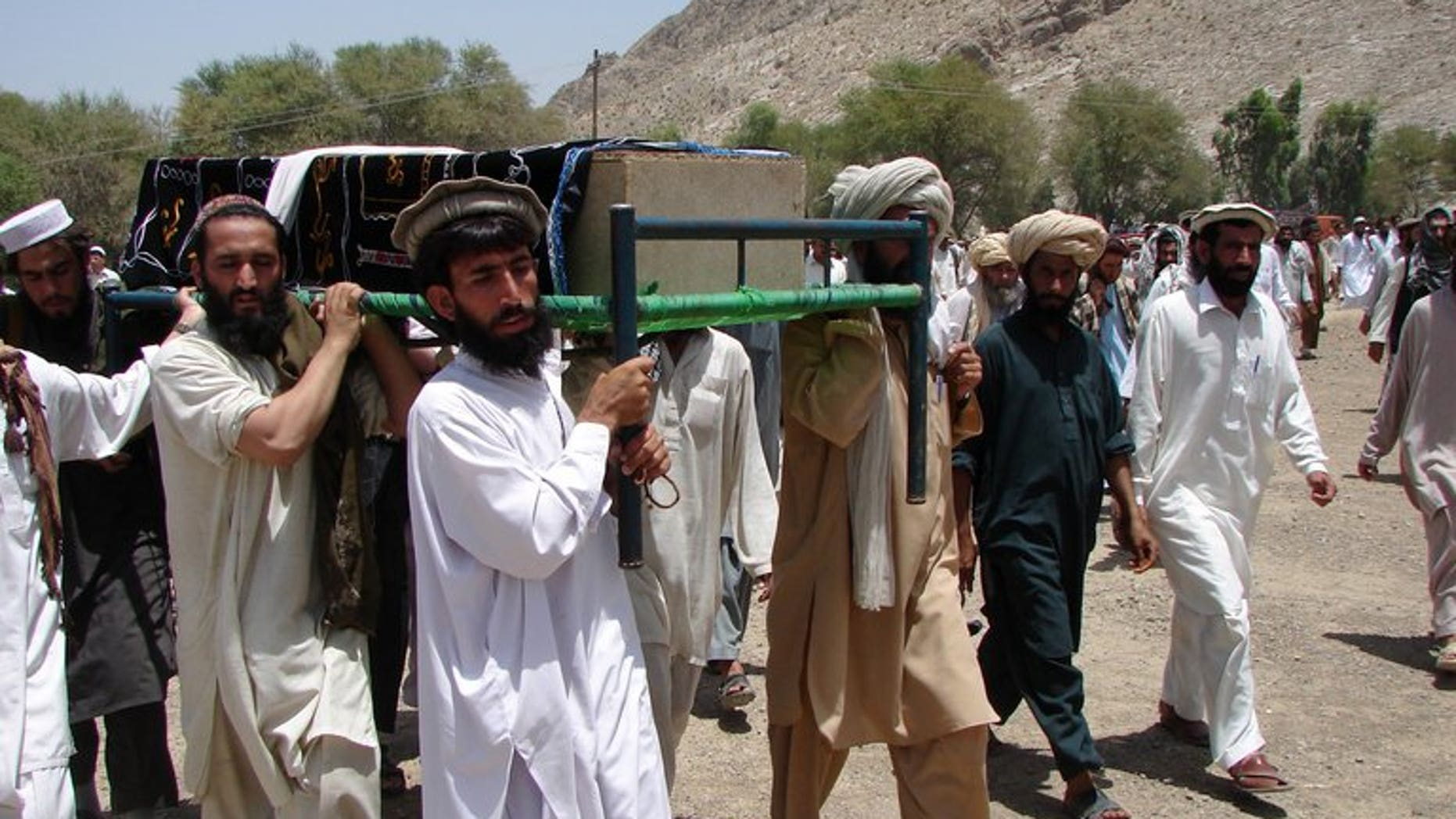Pakistani tribesmen carry the coffin of a person allegedly killed in a US drone attack, in Miranshah, on June 16, 2011. A US drone attack struck a compound of the Al-Qaeda-linked Haqqani network in Miranshah, killing at least 17 militants.
