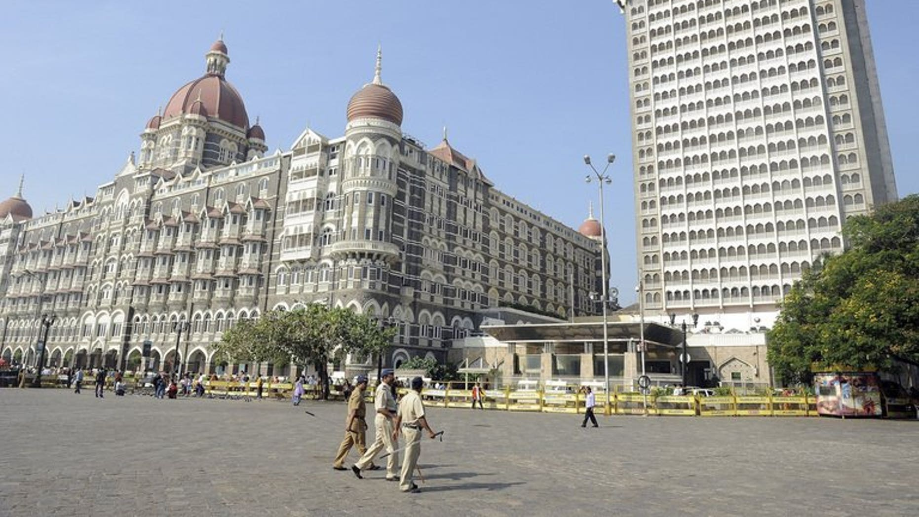 Indian policemen patrol in Mumbai on November 26, 2011. Indian investigators seized more than 100 bags stuffed with cash, gold and diamond jewellery during a raid on four trucks in Mumbai, marking one of the city's largest such hauls, reports and officials said Wednesday.