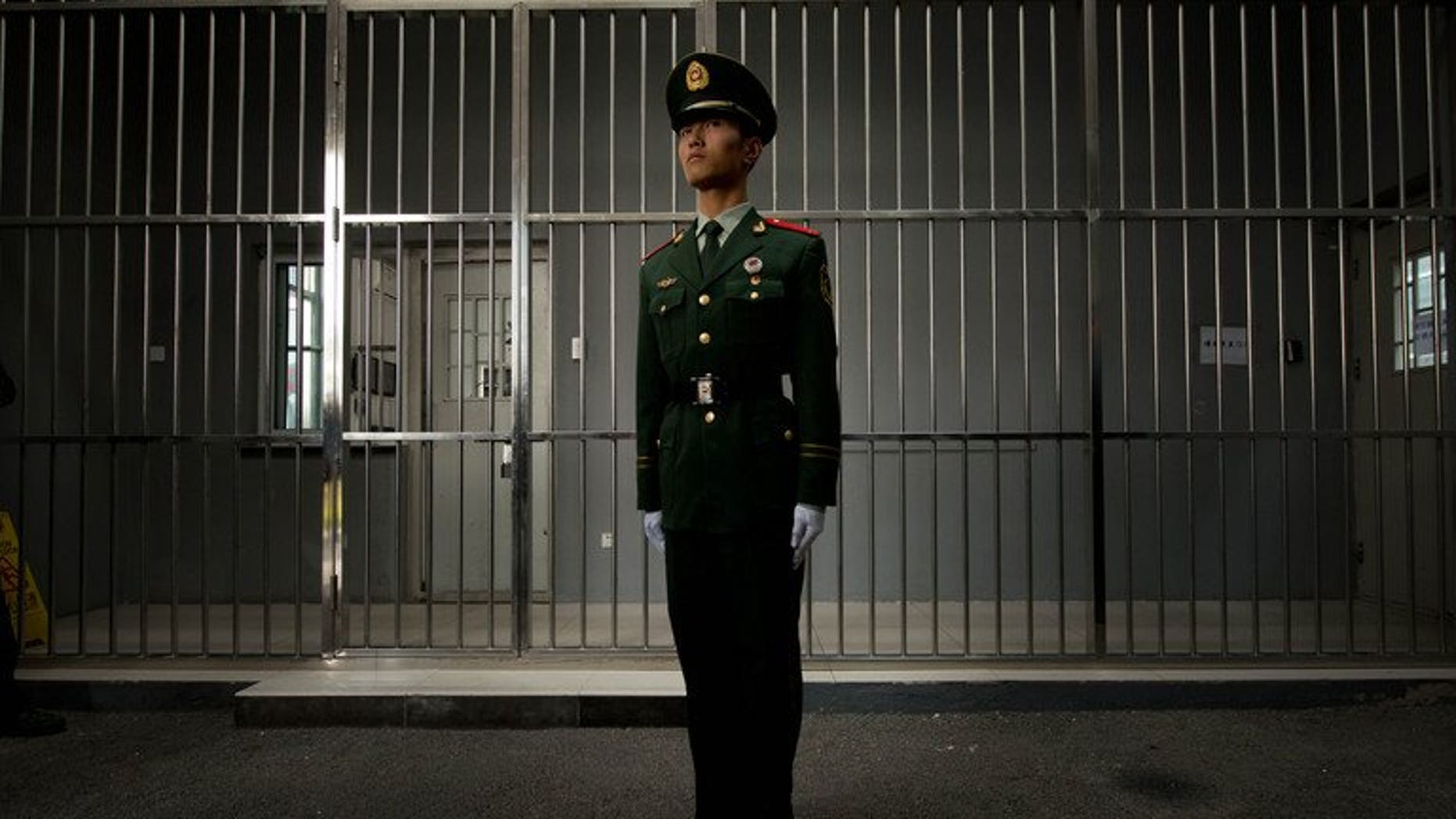 A paramilitary guard stands before the bars of a main gate to the No.1 Detention Center during a government guided tour in Beijing on October 25, 2012. China put to death a Filipina drug trafficker Wednesday, the Philippine foreign department said, after Beijing ignored Manila's request to spare her life.