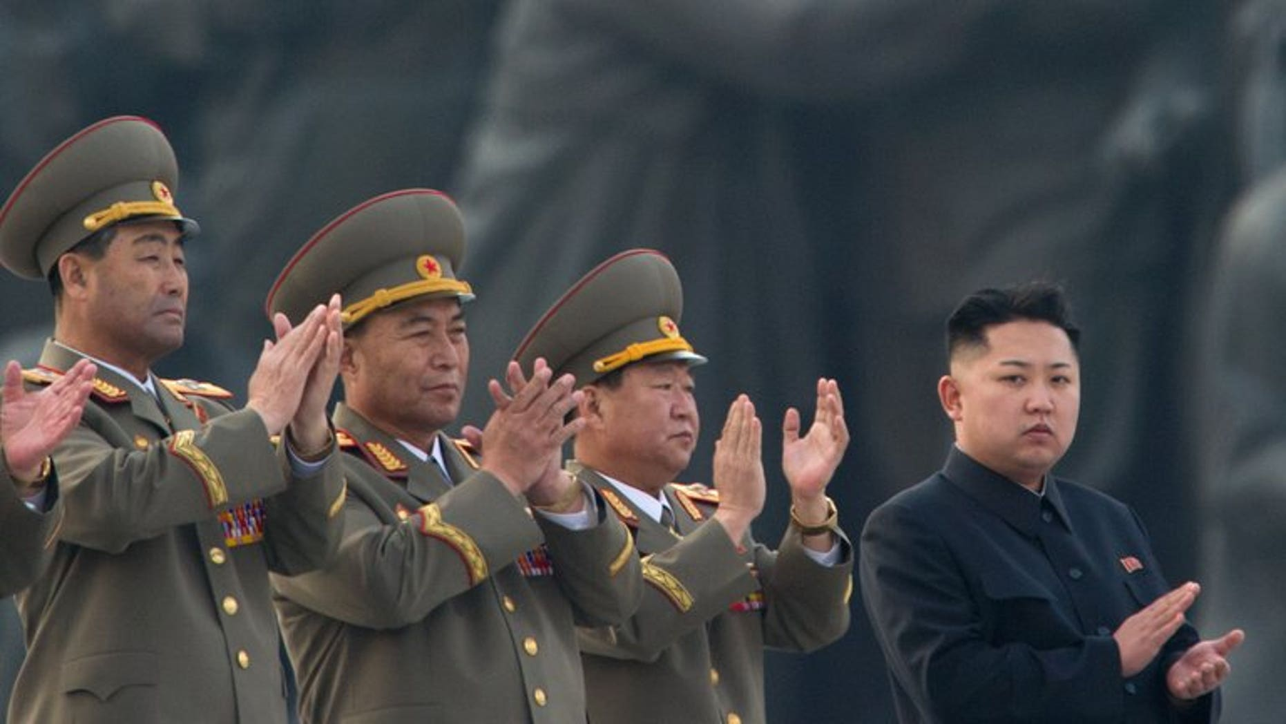 North Korean leader Kim Jong-Un (right) claps during the unveiling ceremony of two statues of former leaders Kim Il-Sung and Kim Jong-Il in Pyongyang on April 13, 2012. North Korea on Wednesday restored its official hotline with South Korea and announced it would let the South's businessmen visit a shuttered joint industrial zone, Seoul officials said.