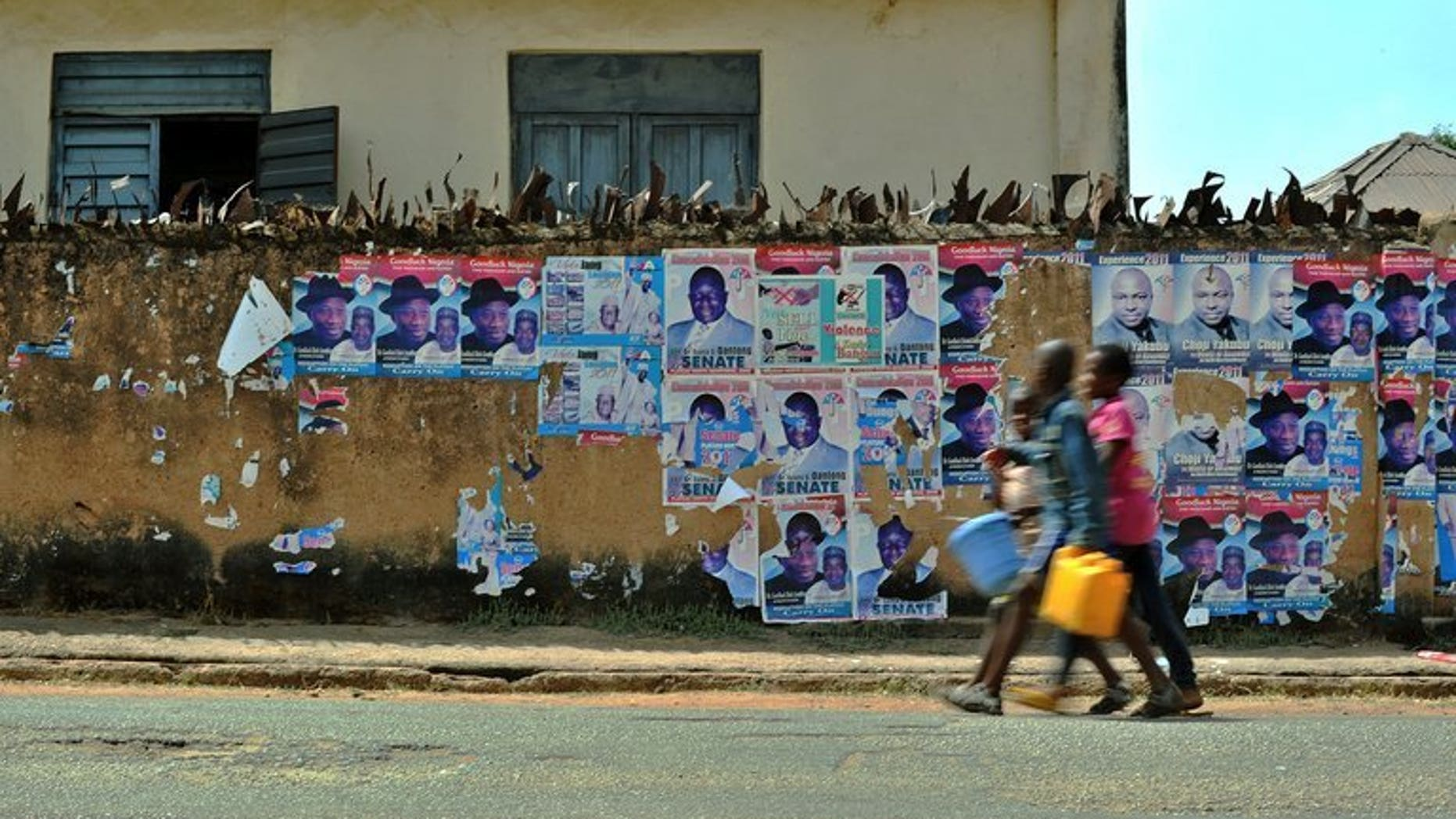 Boys walk along a street in Jos, the administrative capital of Plateau state, in Nigeria's Middle Belt region between the mainly Muslim north and predominately Christian south on April 15, 2011. A military commander claimed on Wednesday that soldiers had since last week killed more than 100 attackers responsible for a deadly raid in ethnically divided central Nigeria.